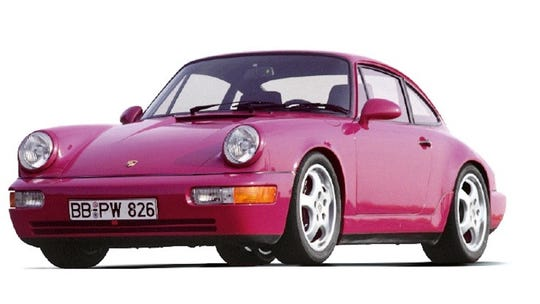 The Porsche 911 RS debuted at the Detroit auto show in 1992.