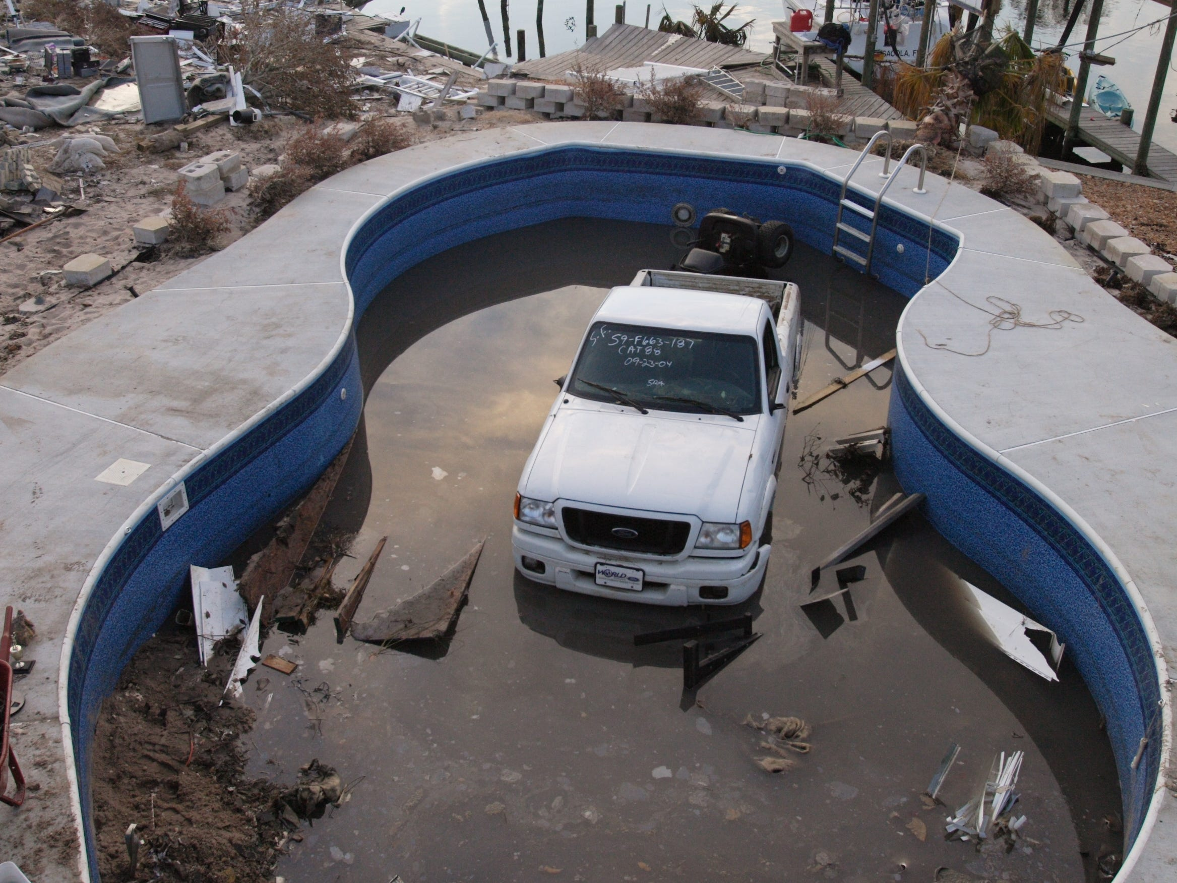 Tom and Kay Matsan's 2004 Ford Ranger Truck, with only 1000 miles on it still sits in the swimming pool behind their home one week after Hurricane Ivan hit in Pensacola, Fla. Sept, 24, 2004. The truck was parked the other direction in their garage and the storm deposited it into their pool facing the other way.