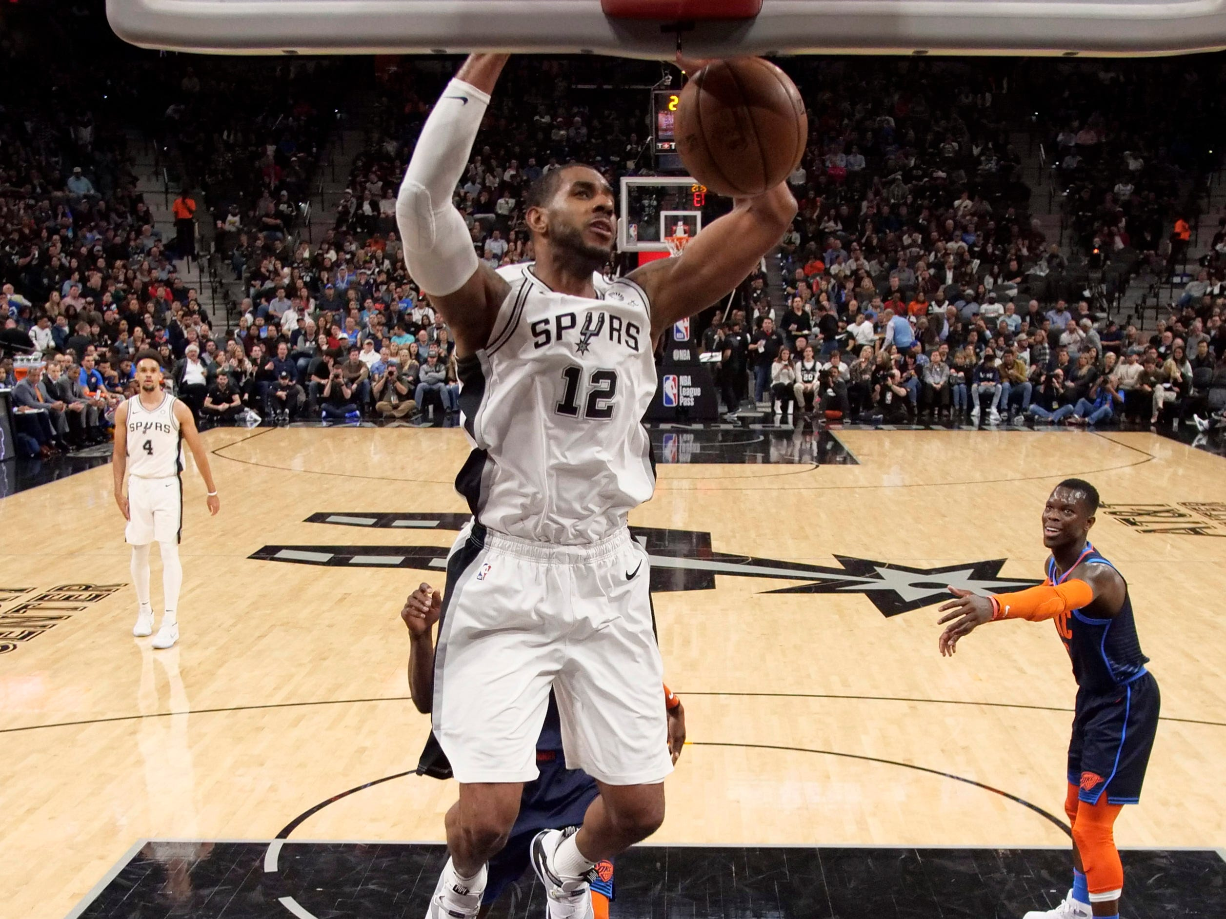 Jan. 10: LaMarcus Aldridge slams home two of his career-high 56 points in the Spurs' wild 154-147 double-overtime win against the Thunder.