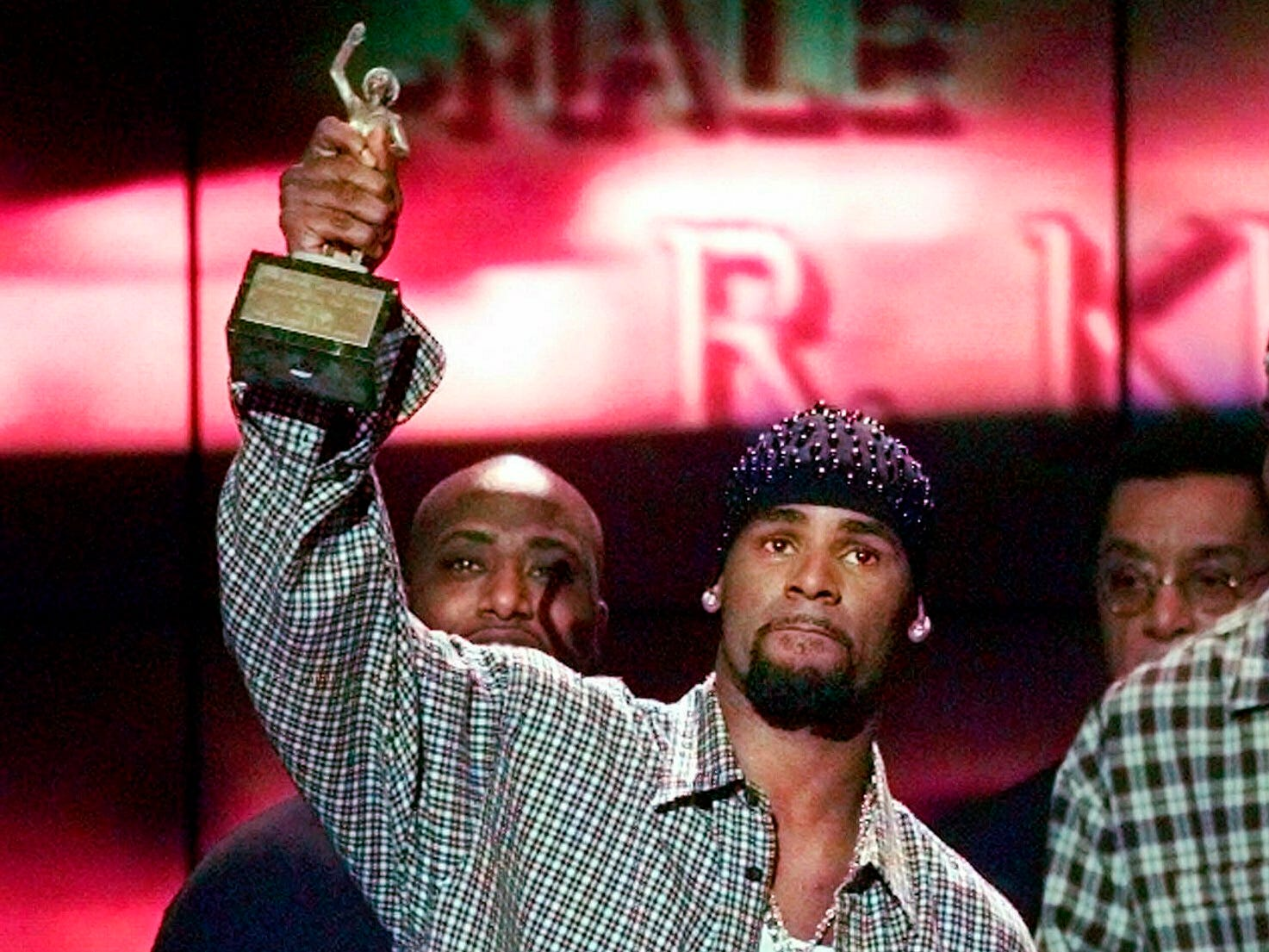 """R. Kelly accepts the Sammy Davis Jr. Award for Male """"Entertainer of the Year"""" at the 13th annual Soul Train Music Awards in Los Angeles on March 26,1999."""