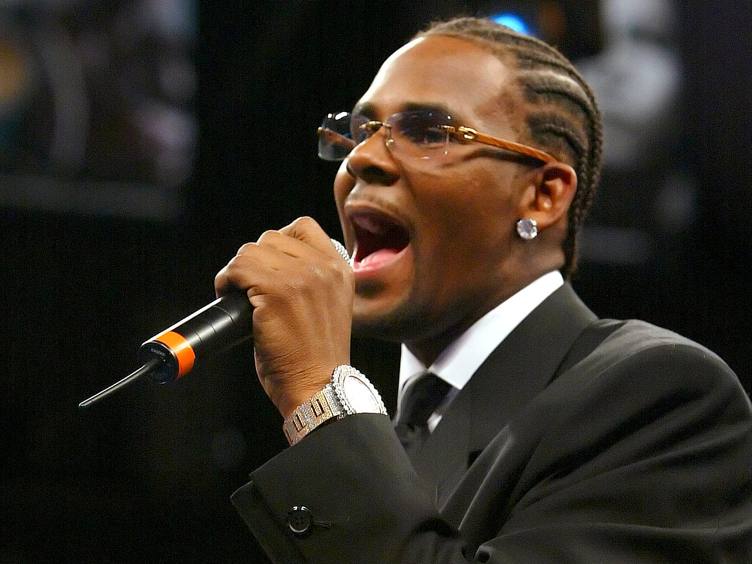 R. Kelly sings the Nation Anthem before the Jermain Taylor-Bernard Hopkins undisputed world middleweight championship bout on Dec. 3, 2005, in Las Vegas.