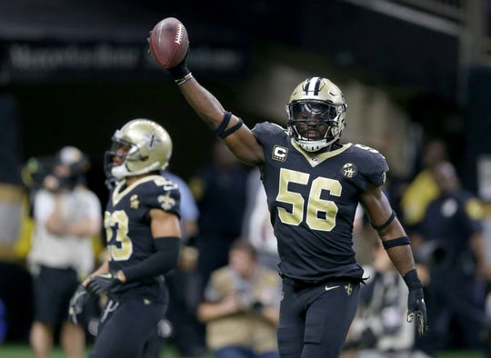 New Orleans Saints outside linebacker Demario Davis (56) celebrates his fumble recovery in the fourth quarter against the Pittsburgh Steelers at the Mercedes-Benz Superdome.