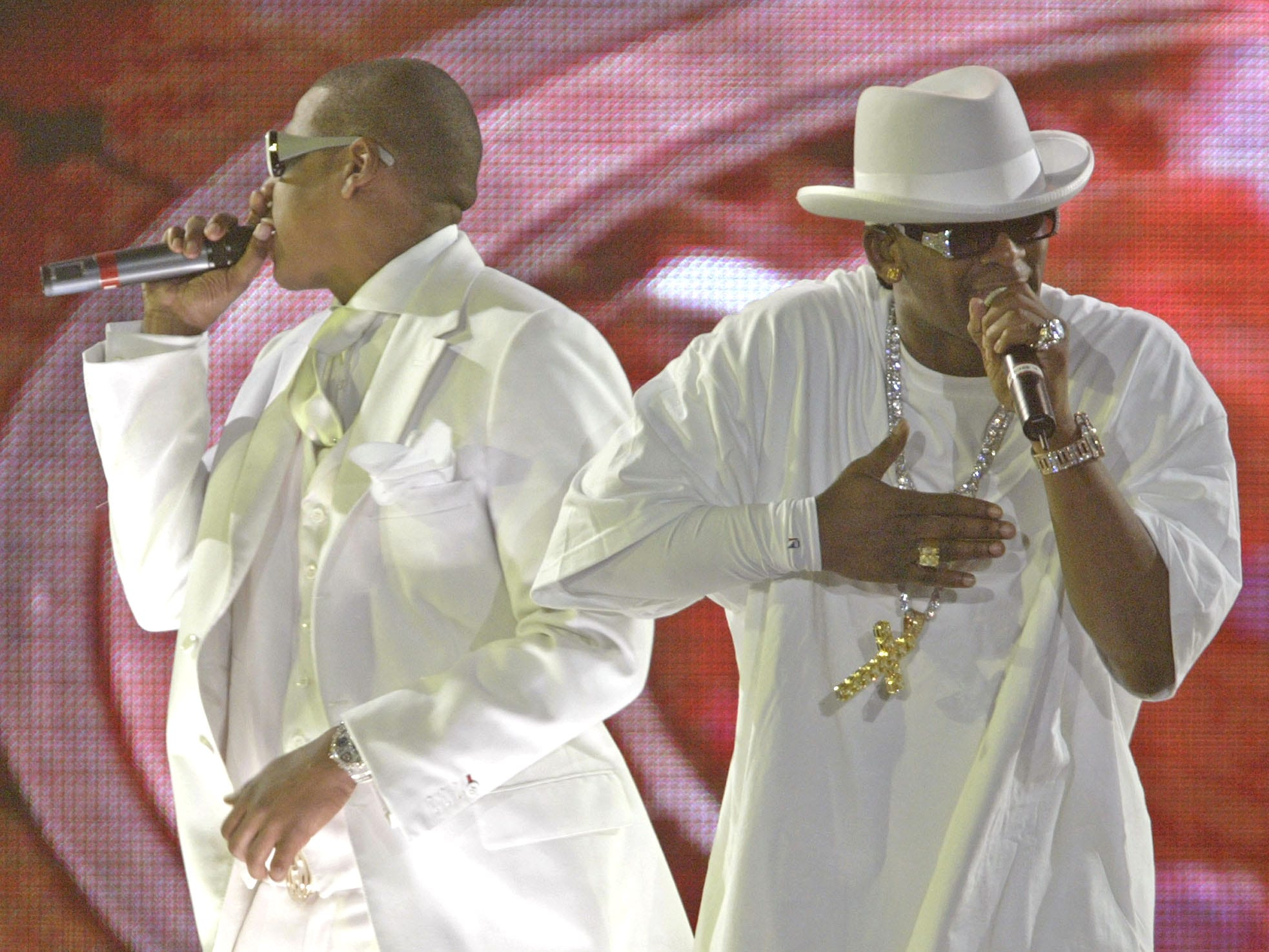 R. Kelly, right, and Jay-Z perform at the Allstate Arena in Rosemont, Ill. at the first stop in their Best of Both Worlds Tour, on Sept. 30, 2004.