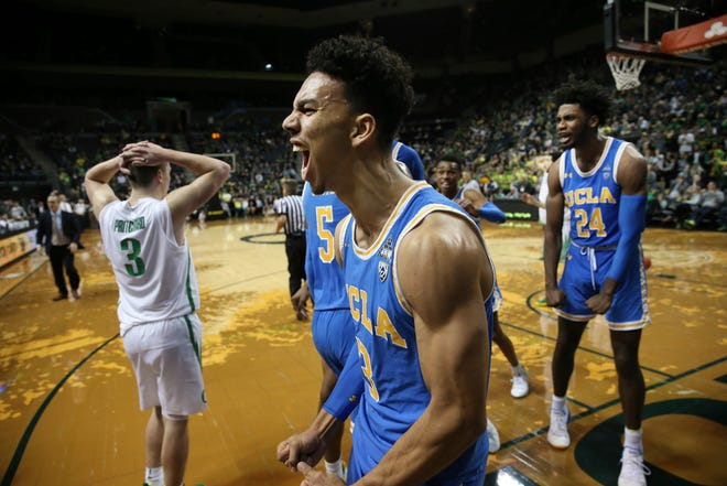 Oregon's Payton Pritchard, left, reacts as UCLA's Jules Bernard, center, and Jalen Hill, right, as they close the gap on the Ducks in the closing seconds of regulation of an NCAA college basketball game Thursday, Jan 10, 2019, in Eugene, Ore.