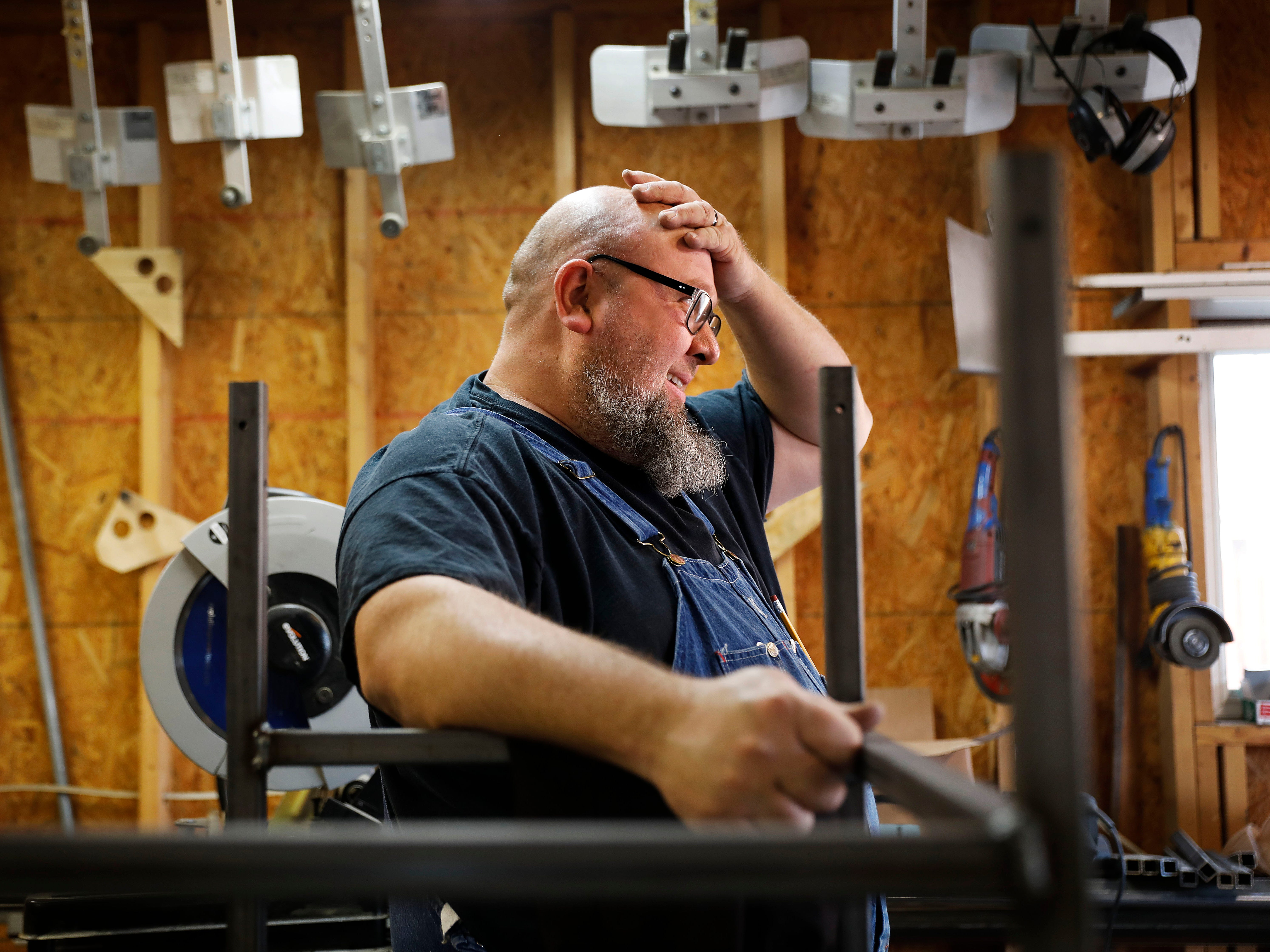 "Jack Lyons, a contractor working on massive rocket test stands for NASA, stands in his workshop while spending the furlough on his small side business making props for marching bands, in Madison, Ala., Jan. 8, 2019. ""They're trying to use people as bargaining chips, and it just isn't right,"" Lyons said. Unlike civil service workers who expect to eventually get back pay, Lyons doesn't know if he'll ever see a dollar from the shutdown period."