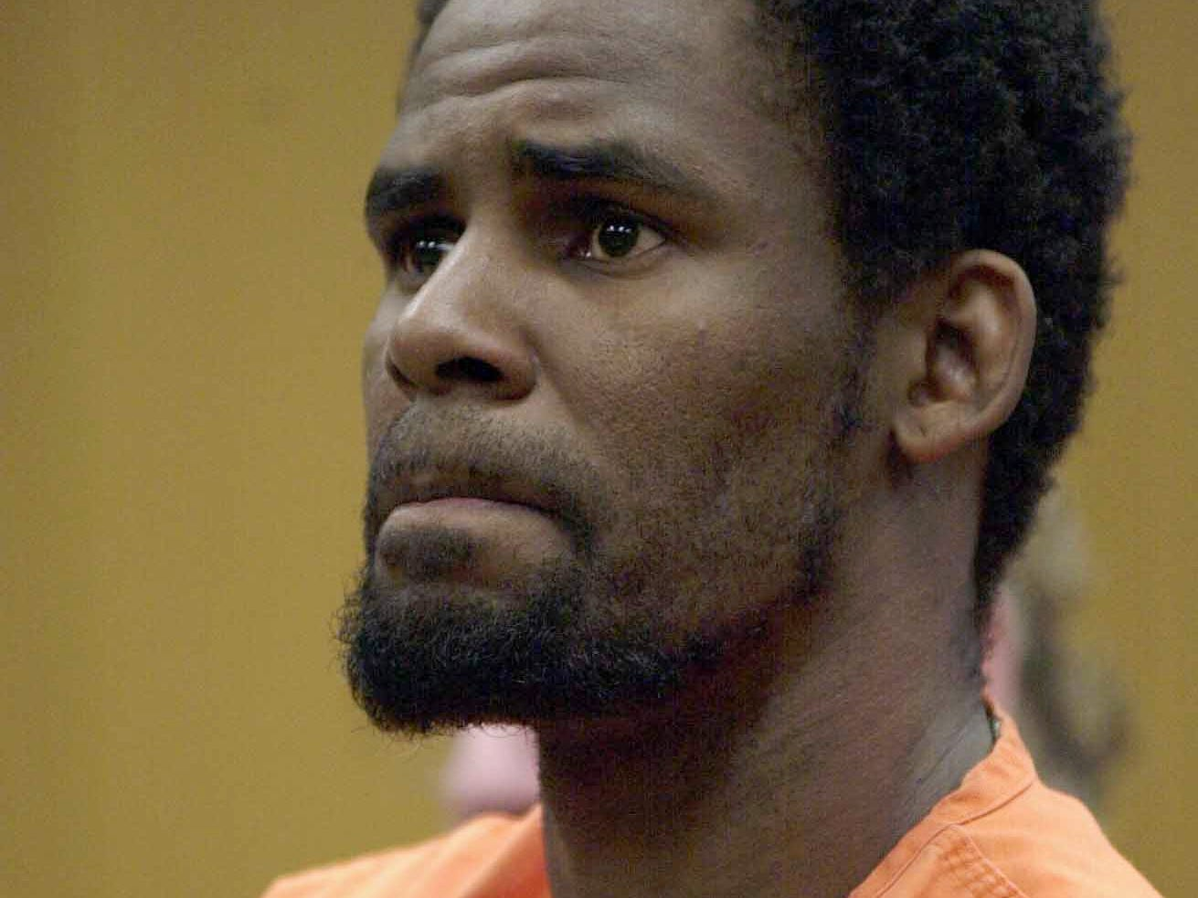 R. Kelly looks at Polk County Judge Karla Wright during his court appearance on June 6, 2002, in Bartow, Fla.  Kelly was arrested in Davenport, Fla., and charged with 21 counts of child pornography.