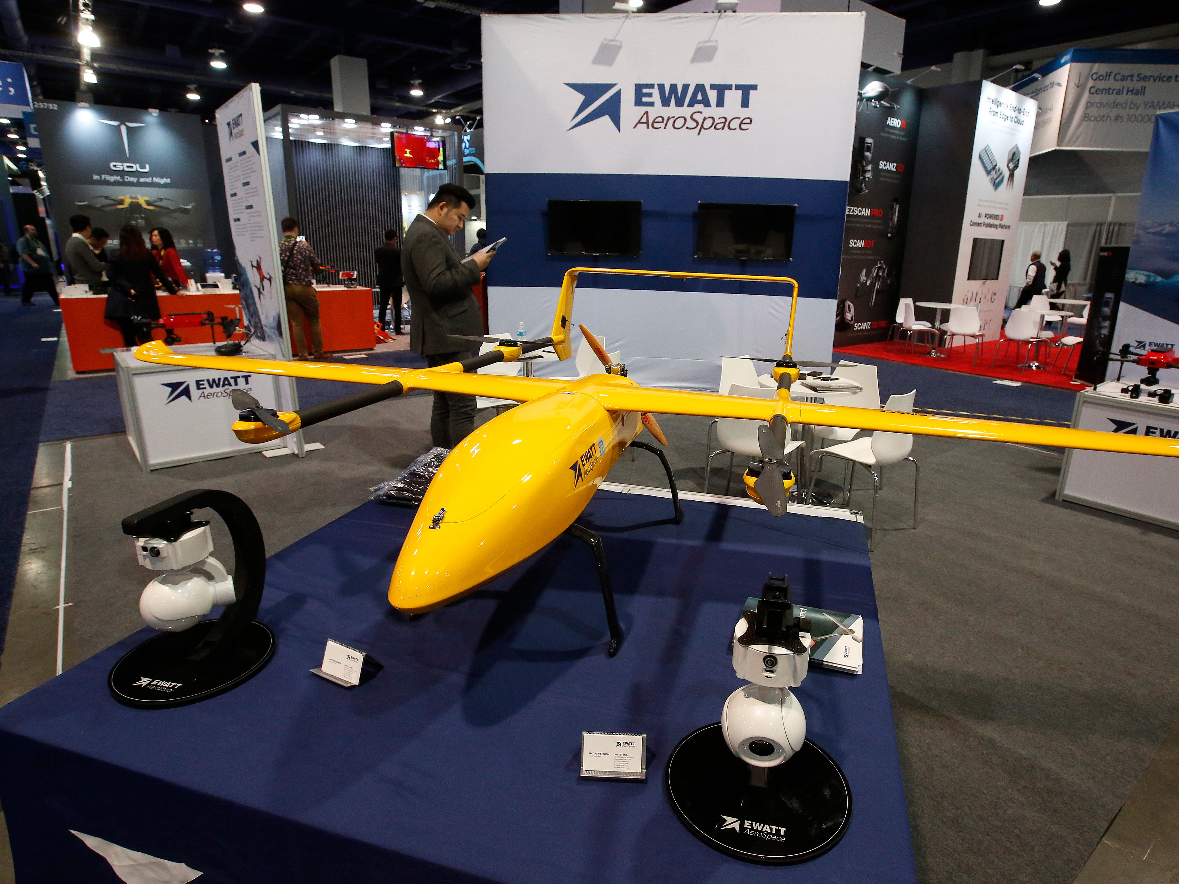 A drone sits on display at the Ewatt AeroSpace booth.