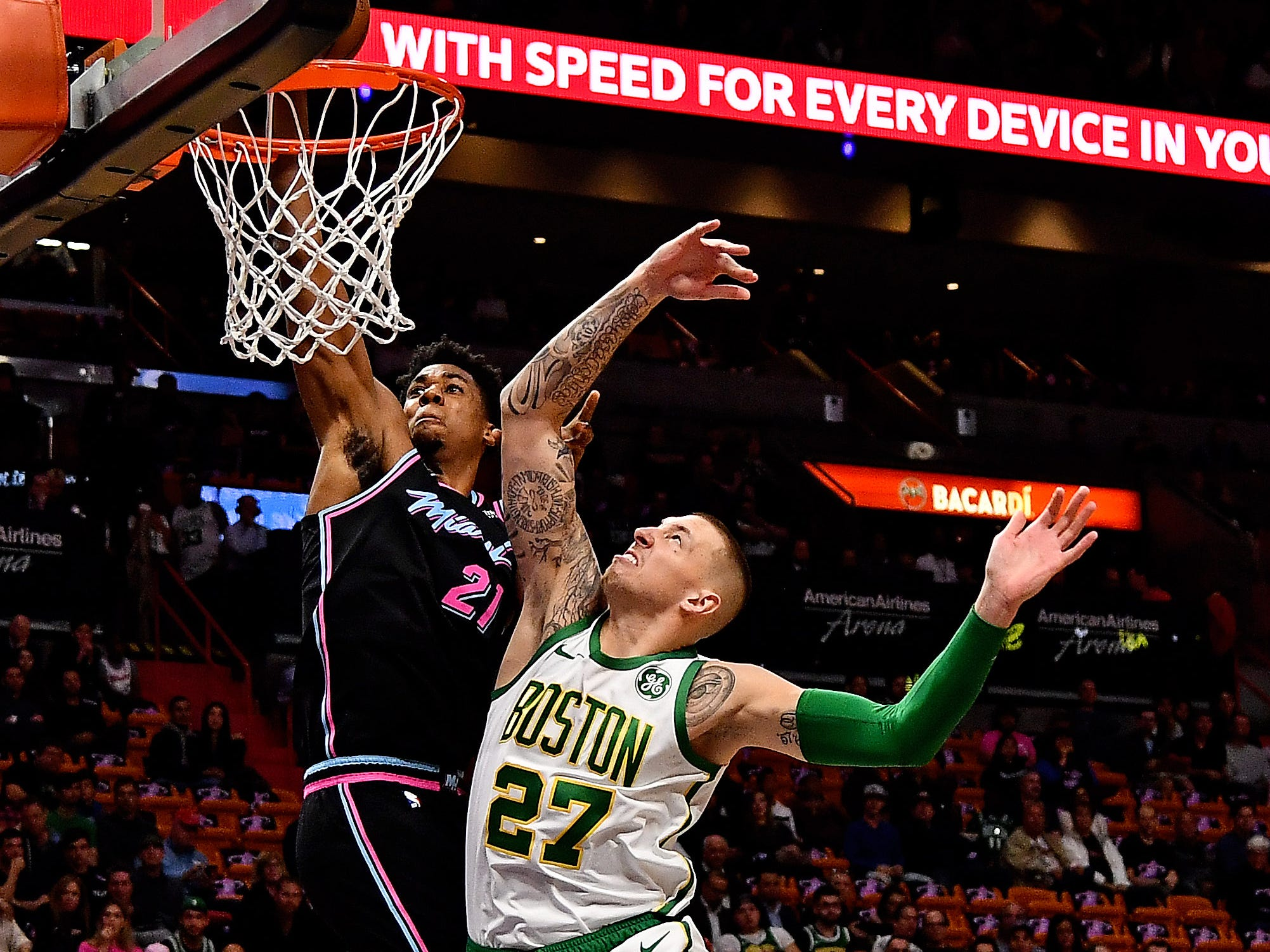 Jan. 10: Heat center Hassan Whiteside (21) throws down a one-handed flush over Celtics defender Daniel Theis (27) during the first half in Miami.