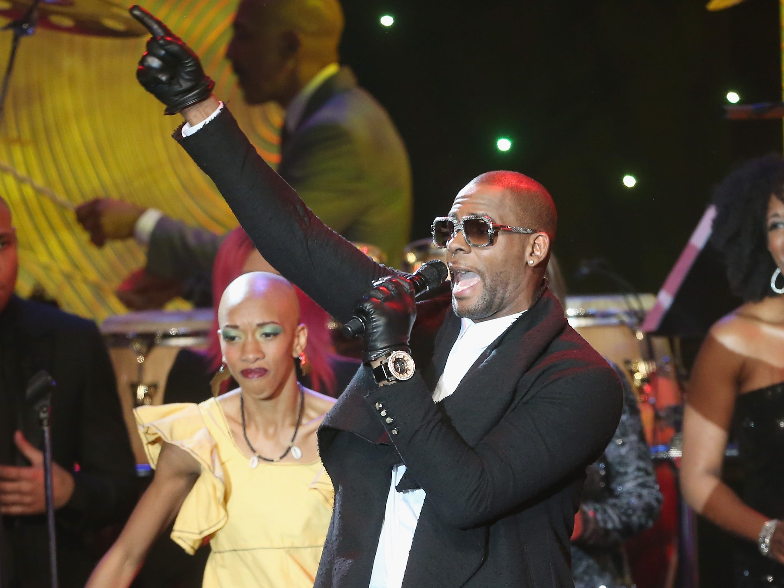 R. Kelly performs onstage during the 56th annual Grammy Awards Pre-Grammy Gala and Salute to Industry Icons honoring Lucian Grainge at The Beverly Hilton on Jan. 25, 2014, in Beverly Hills.