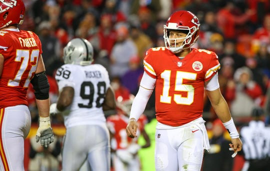 Kansas City Chiefs quarterback Patrick Mahomes (15) reacts after a play against the Oakland Raiders at Arrowhead Stadium.