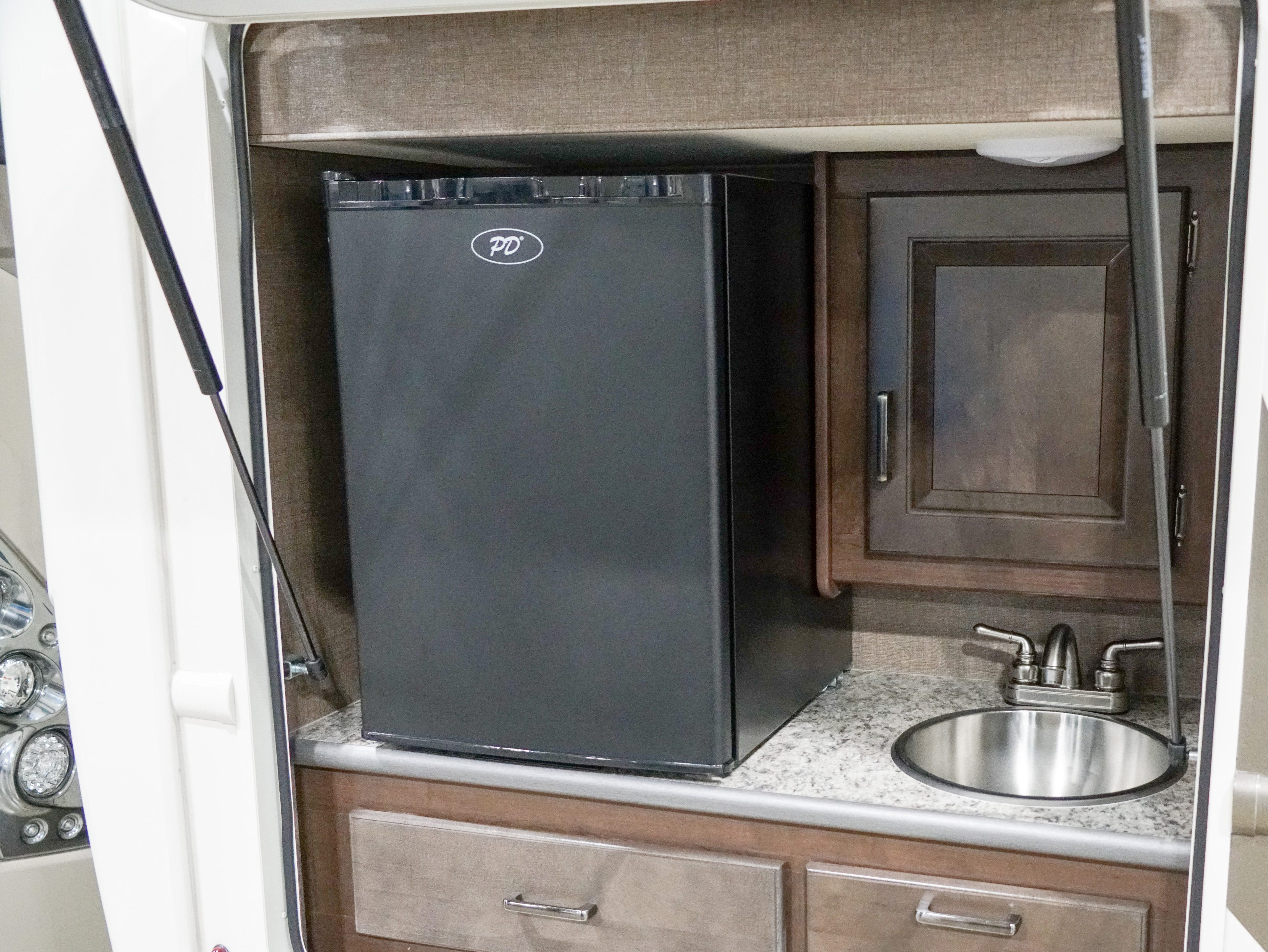 Outdoor sinks and refrigerators are now common on many larger RV trailers.