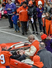 Clemson Head Coach Dabo Swinney signs an autograph during the National Championship parade for the Clemson Tigers football team in Clemson Saturday, January 12, 2019.