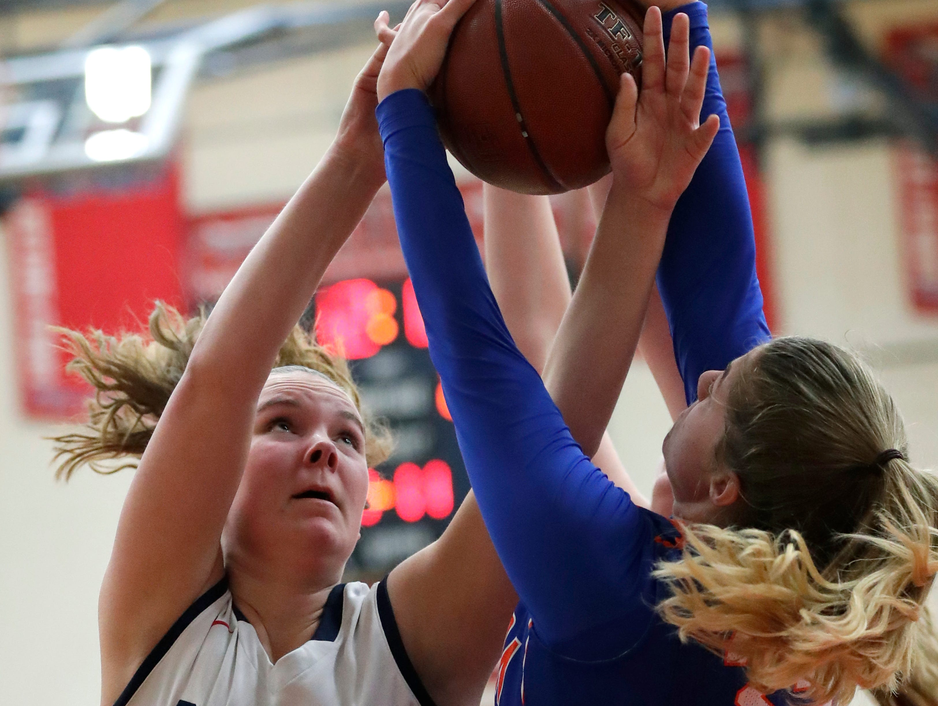 Appleton East High School's Lily Wendland (35) battles for a rebound against Appleton West High School's Sydney Gehl (35) during their girls basketball game Friday, January 11, 2019, at Appleton East High School in Appleton, Wis. 