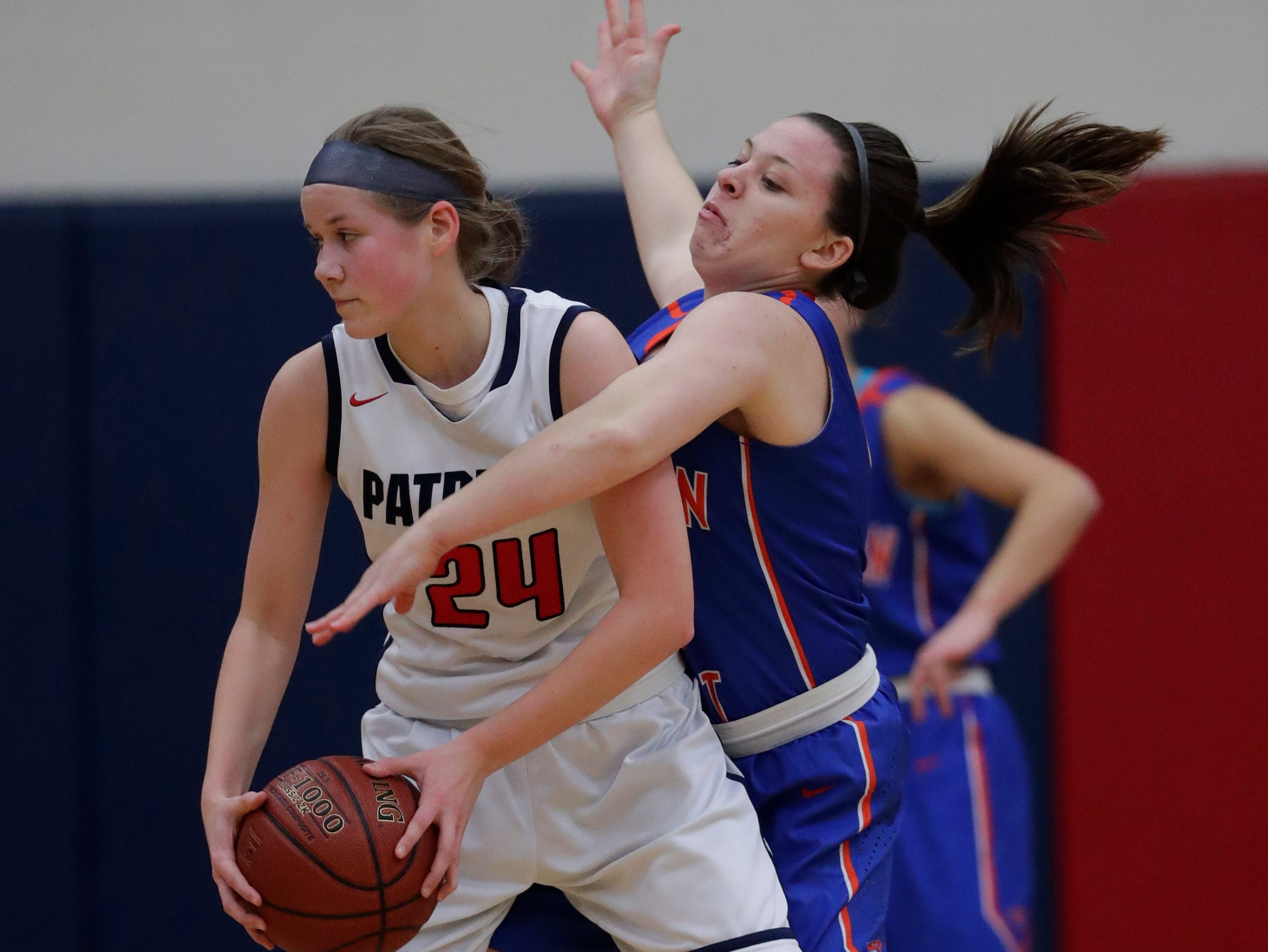 Appleton East High School's Delaney Clark (24) looks to pass the ball against Appleton West High School's Haley Peterson (13) during their girls basketball game Friday, January 11, 2019, at Appleton East High School in Appleton, Wis. 