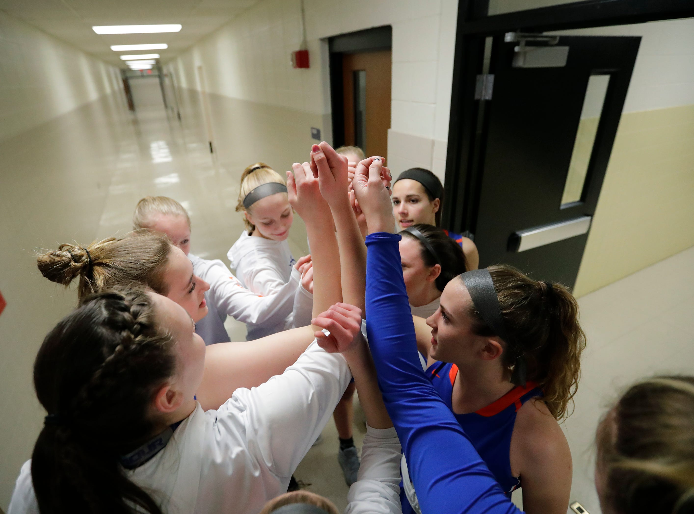 Appleton West High School's players get ready to take to the court against Appleton East High School moments before their girls basketball game Friday, January 11, 2019, at Appleton East High School in Appleton, Wis. 