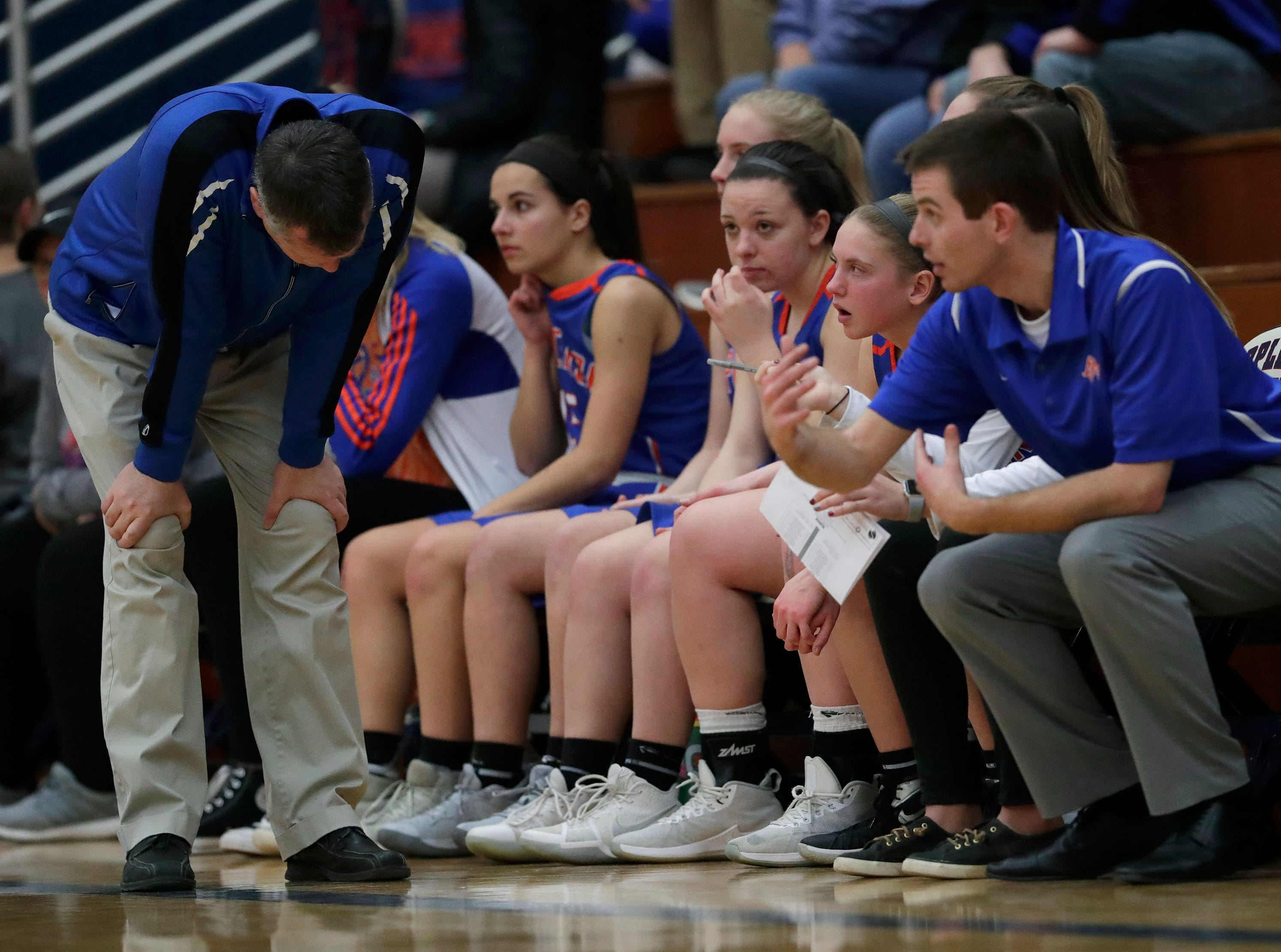 Appleton West High School's coachJim Brown, left, shows his frustration early in the game against Appleton East High School during their girls basketball game Friday, January 11, 2019, at Appleton East High School in Appleton, Wis. 
