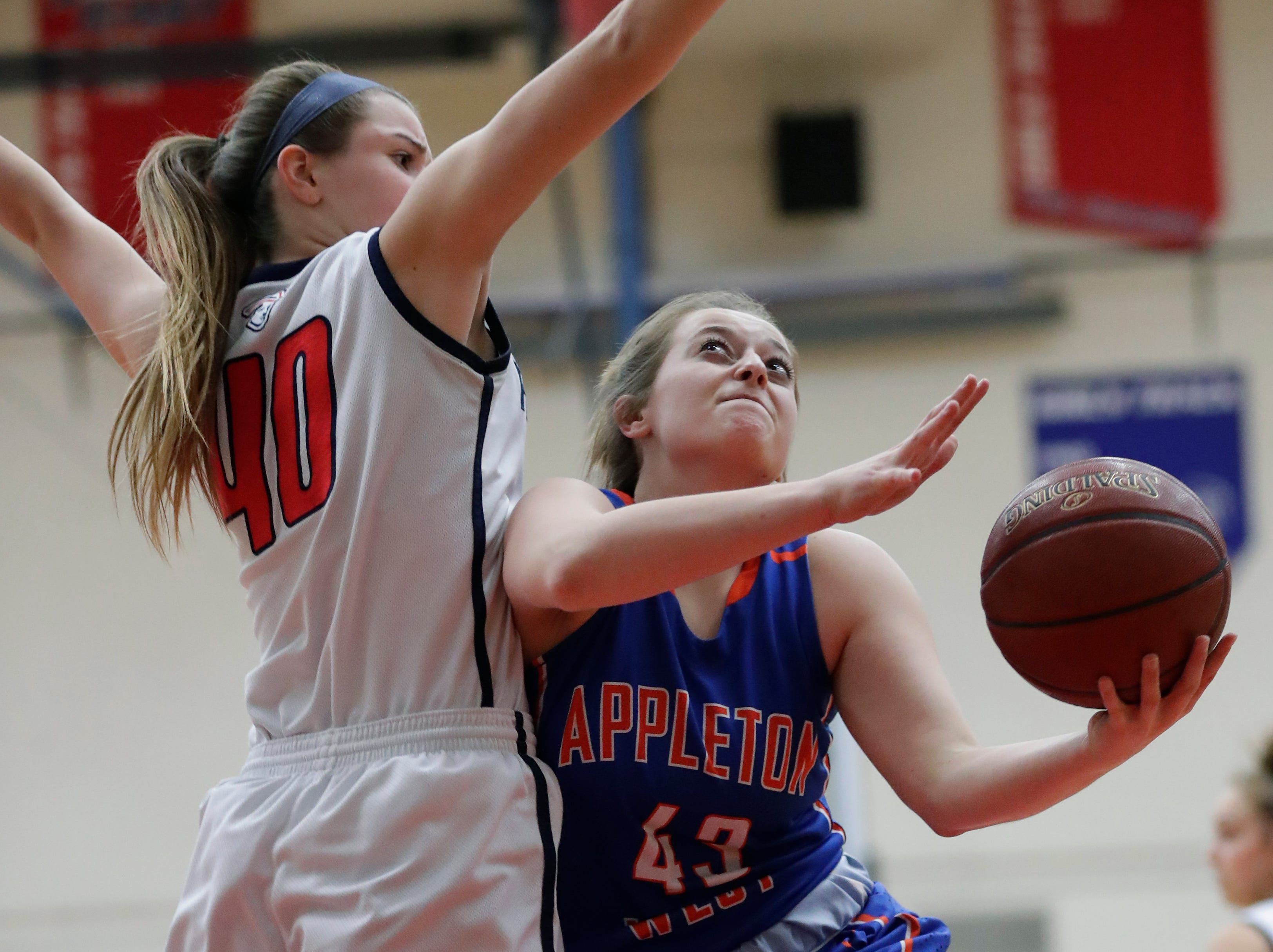 Appleton East High School's Abbie King (40) defends against Appleton West High School's Jenna Hoffman (43) during their girls basketball game Friday, January 11, 2019, at Appleton East High School in Appleton, Wis. 