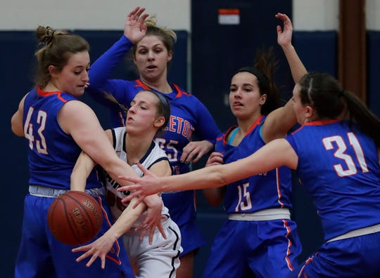 Appleton East's Meghan Borowski (15) is under heavy defensive pressure from Appleton West's Jenna Hoffman (43), Sydney Gehl (35), Addie Pauling (15) and Christy Fortune (31) during their game Jan. 11 at Appleton East.
