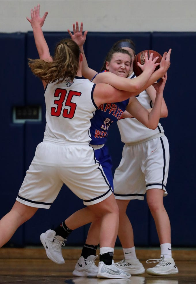 Appleton East High School's Lily Wendland (35) defends against Appleton West High School's Christy Fortune (31) during their girls basketball game Friday, January 11, 2019, at Appleton East High School in Appleton, Wis. 