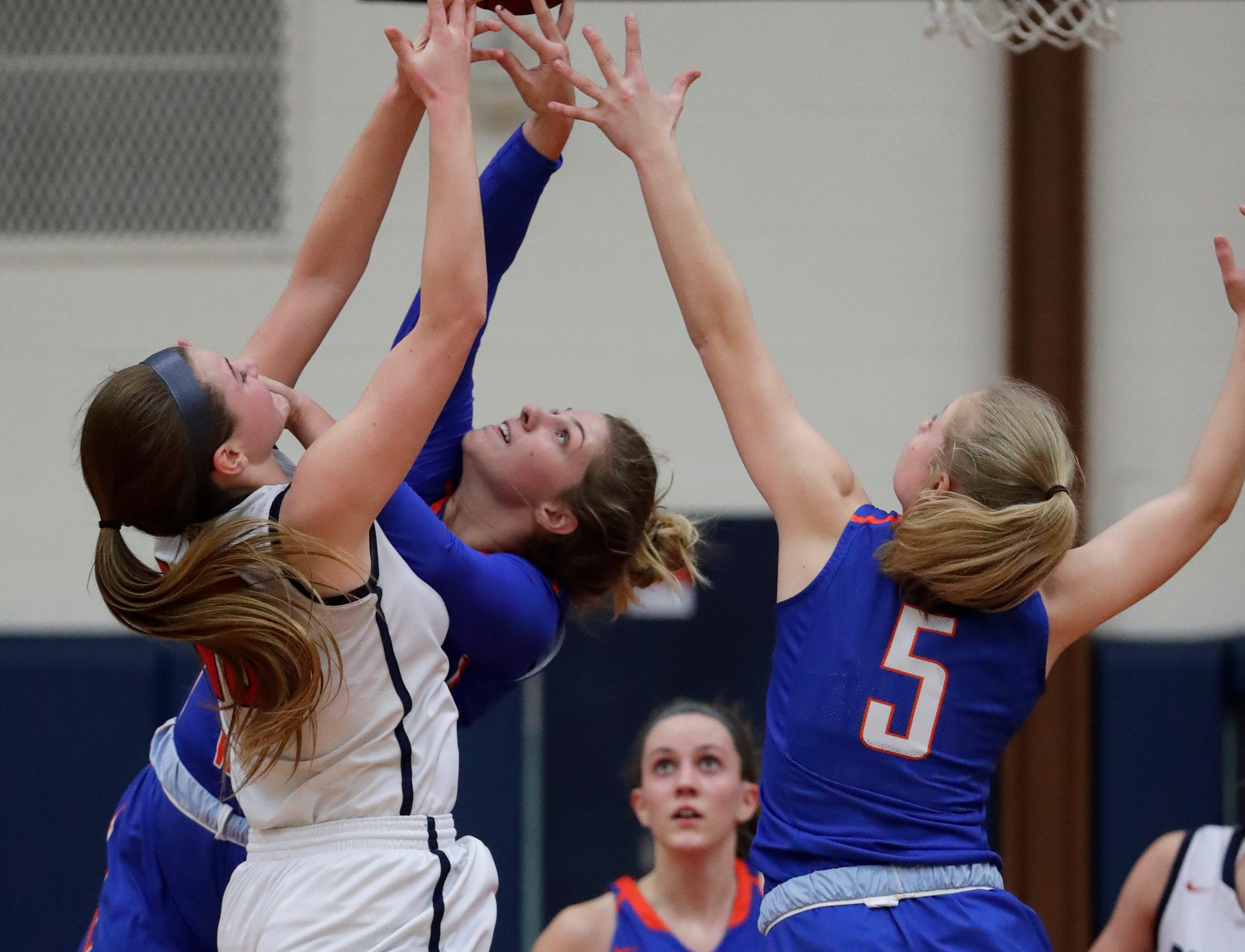 Appleton East High School's Abbie King (40) goes up for a rebound against Appleton West High School's Jenna Hoffman (43) and Bree Workman (5) during their girls basketball game Friday, January 11, 2019, at Appleton East High School in Appleton, Wis. 