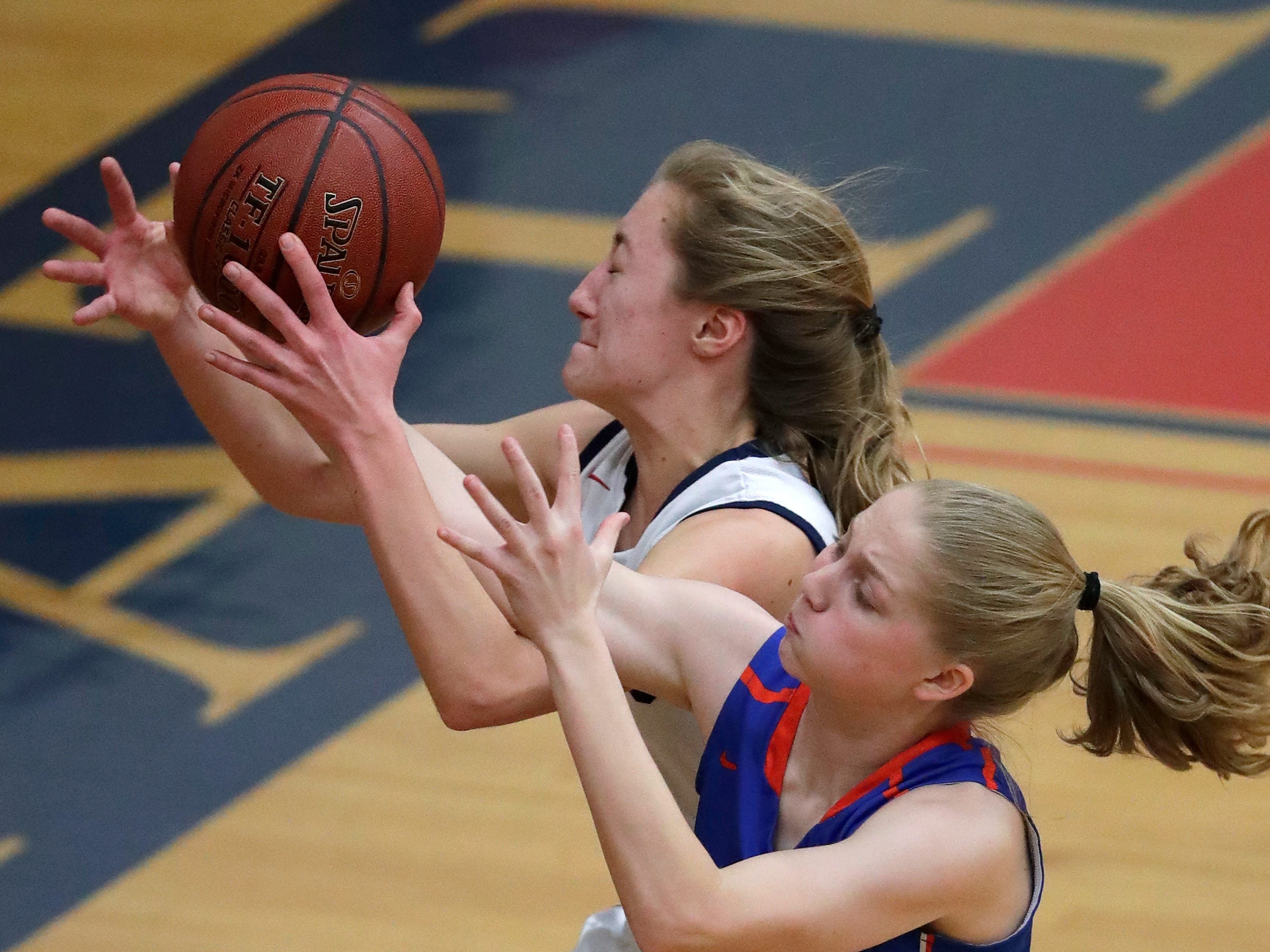 Appleton East High School's Cameron Neubauer (10) chases down a loose ball against Appleton West High School's Jamie Winsted (11) during their girls basketball game Friday, January 11, 2019, at Appleton East High School in Appleton, Wis. 
