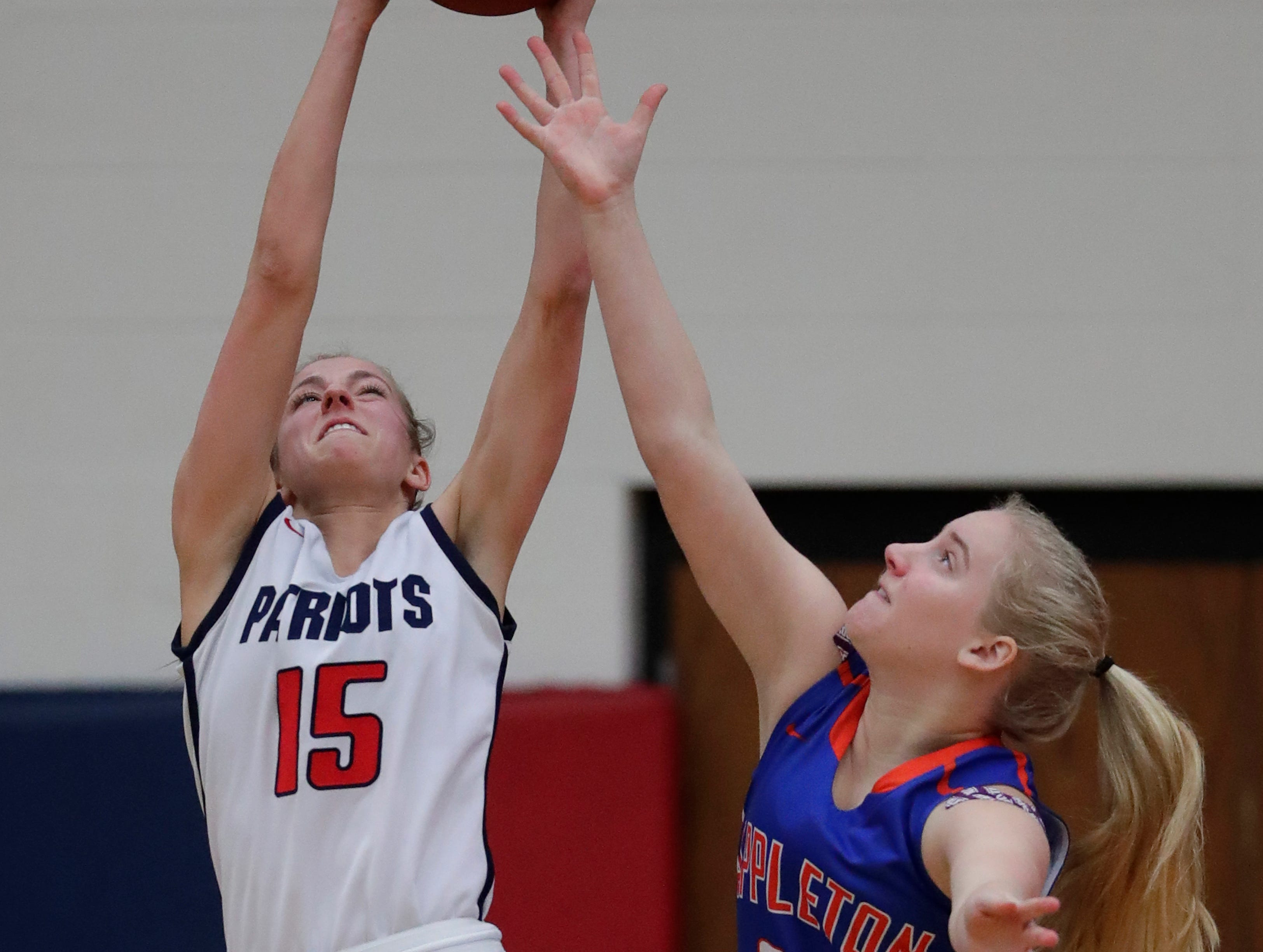 Appleton East High School's Meghan Borowski (15) pulls down a rebound against Appleton West High School's McKayla Knoebel (33) during their girls basketball game Friday, January 11, 2019, at Appleton East High School in Appleton, Wis. 