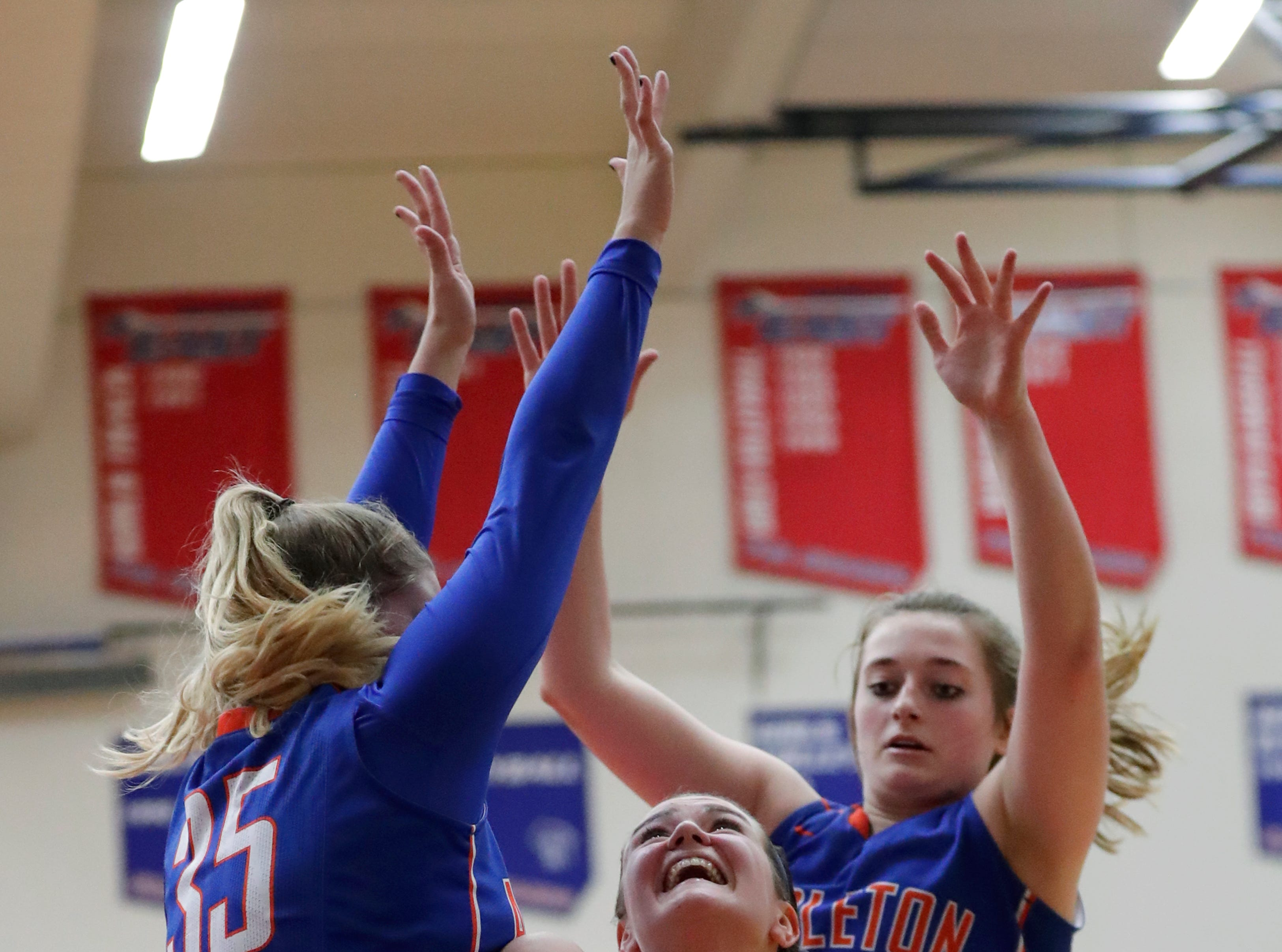Appleton East High School's Abbie King (40) tries to put up a shot against Appleton West High School's Sydney Gehl (35) and Jenna Hoffman (43) during their girls basketball game Friday, January 11, 2019, at Appleton East High School in Appleton, Wis. 