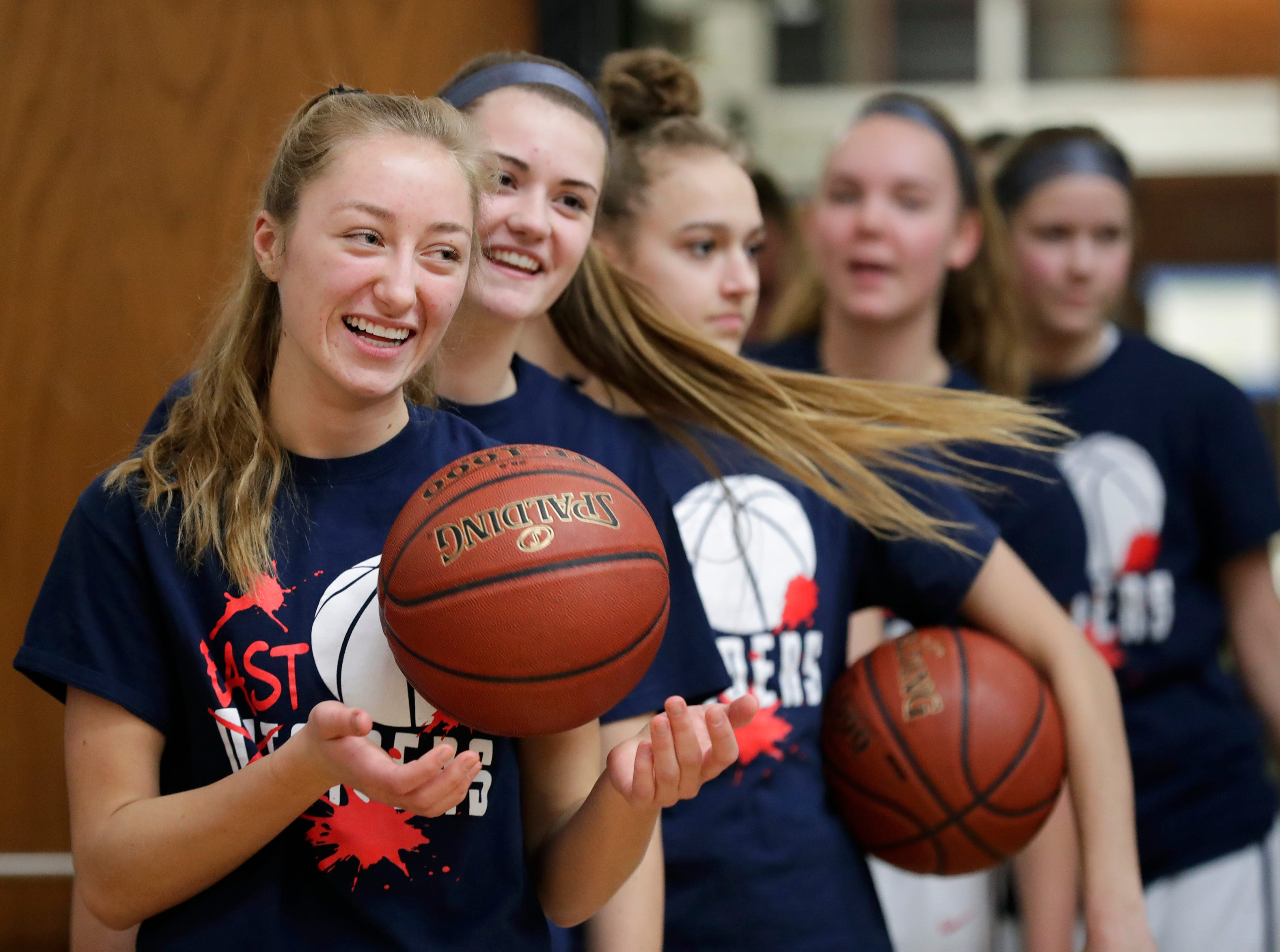 Appleton East High School's Cameron Neubauer and her teammates are ready to play against Appleton West High School prior to the start of their girls basketball game Friday, January 11, 2019, at Appleton East High School in Appleton, Wis. 