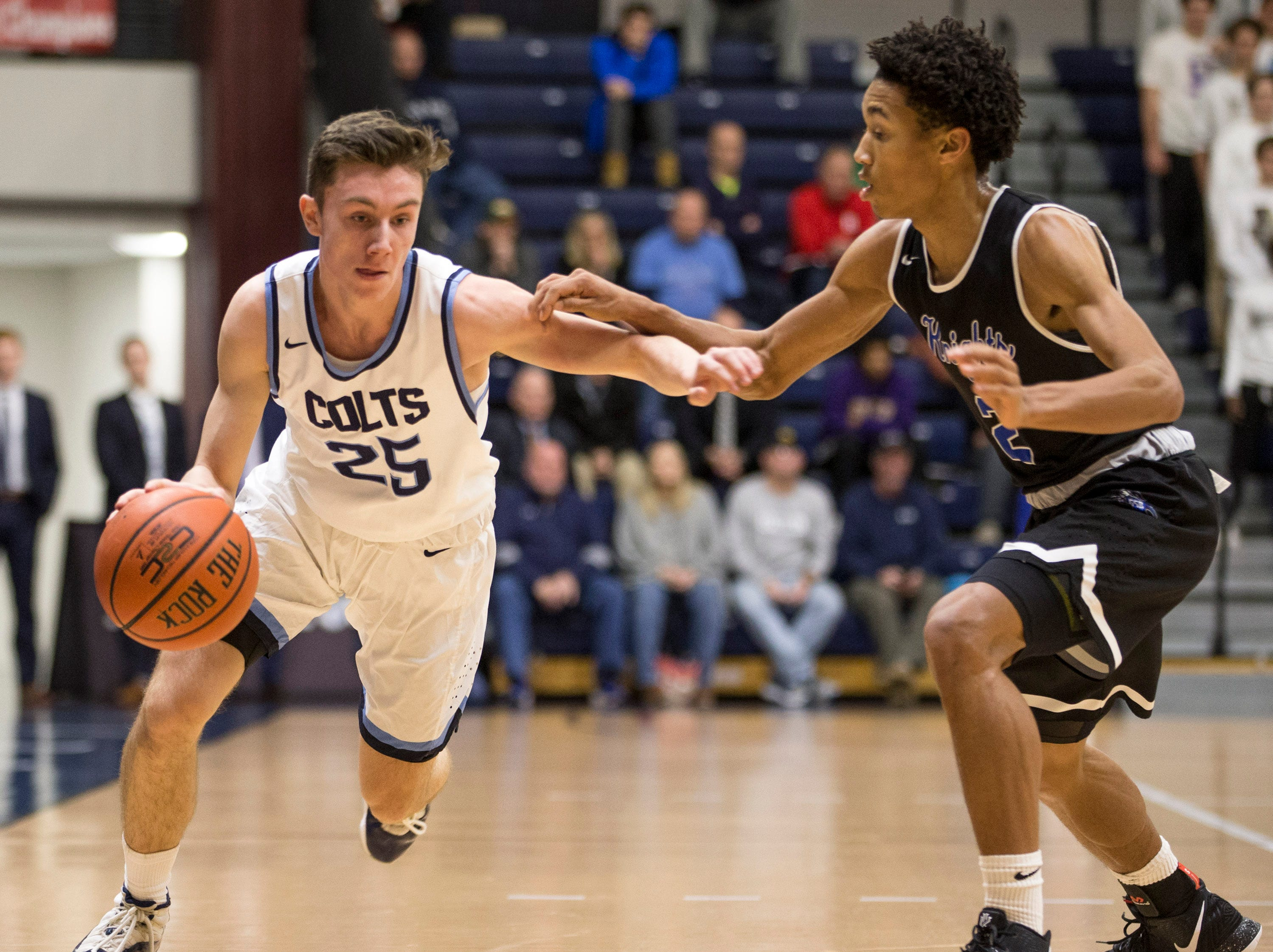 Colin Farrell of Christian Brothers Academy drives past Denver Anglin. The 2019 Boardwalk Hoop Group Showcase tournament takes place at Brookdale Community College. Game one features Gill St. Bernard's vs Christian Brothers Academy. Middletown, NJSaturday, January 12, 2019