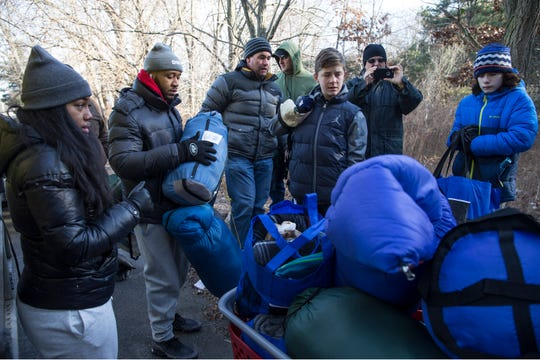 Members of the community come out to offer support for homeless in the area. They delivered sleeping bags and other supplies to help them deal with cold weather. 