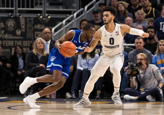 Seton Hall Pirates guard Quincy McKnight (0) drives for the basket against Marquette Golden Eagles guard Markus Howard (0)