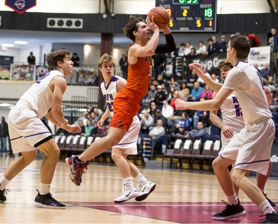 Middletown North's Rob Higgins puts up a shot against Rumson-Fair Haven during the 2019 Boardwalk Hoop Group Showcase at Brookdale Community College.