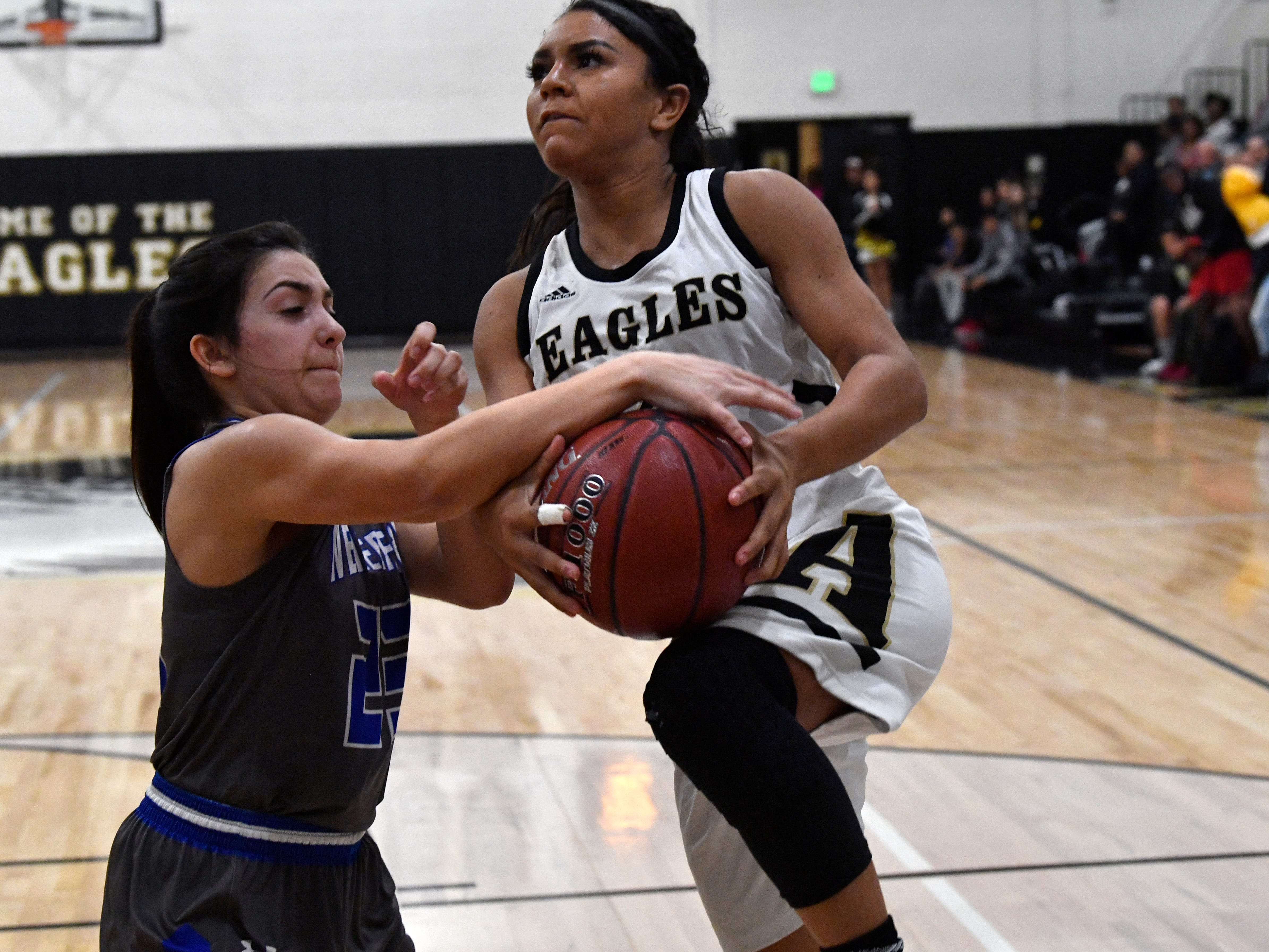 Abilene High's Alyssa Washington is fouled by Weatherford's Sydney Steffler during Friday's game in the Eagle Gym Jan. 11, 2019. Final score was 51-38, Abilene.
