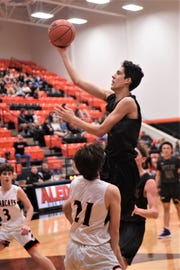 Wylie's Austin Brewer (4) goes over an Aledo defender for a basket in a road District 4-5A contest on Friday, Jan. 11, 2019. The Bulldogs lost 62-60 in double-overtime.