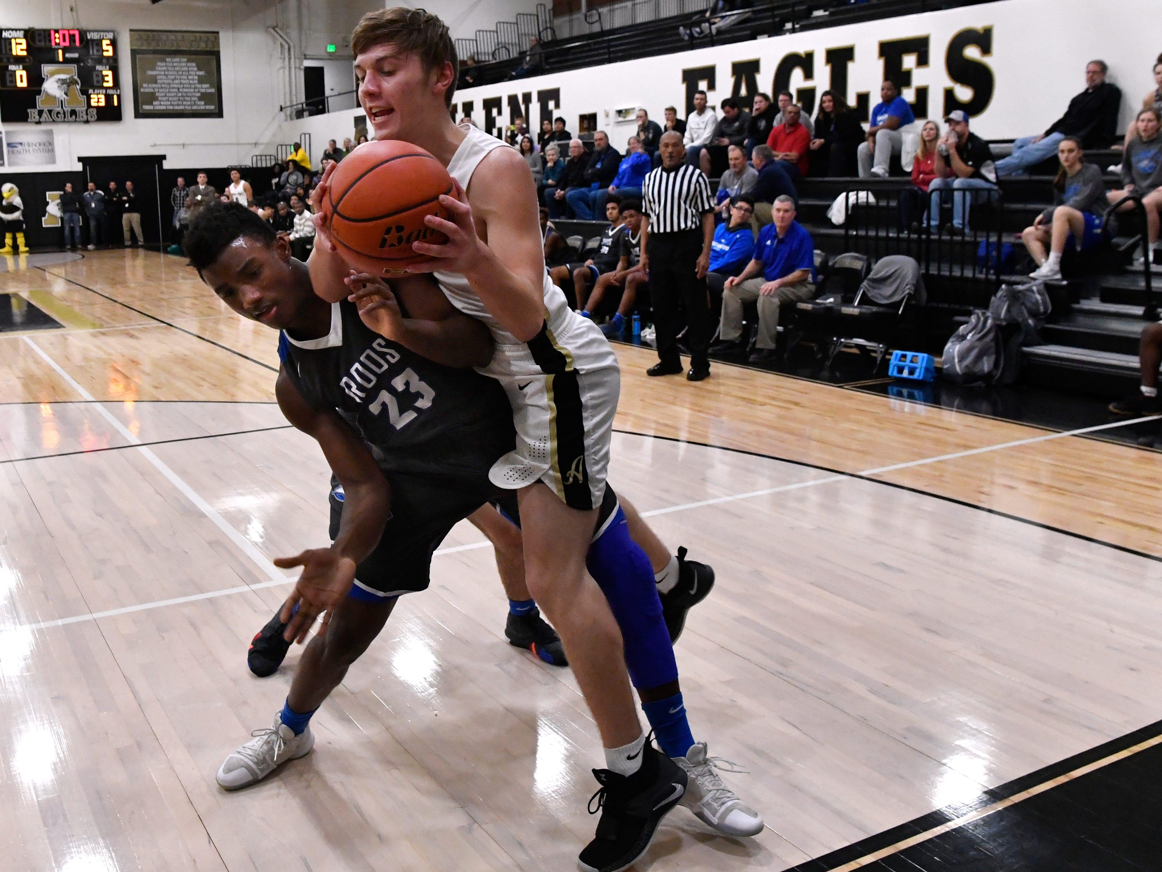 Abilene High's Jackson Stevens comes down onto Weatherford's Brett Blevins during Friday's game in the Eagle Gym Jan. 11, 2019. Final score was 74-49, Abilene.