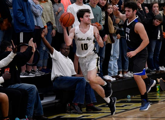 Abilene High's Landon Talley catches the ball and throws it back onto the court before falling out-of-bounds during Friday's basketball game against Weatherford Jan. 11, 2019. Final score was 74-49, Abilene.