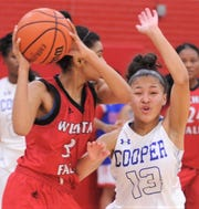 Cooper's Aziah Joe (13) reacts while defending Wichita Falls High's Ashanti Davis. Cooper beat the Lady Coyotes 71-29 in the District 4-5A game Friday, Jan. 11, 2019, at Cougar Gym.
