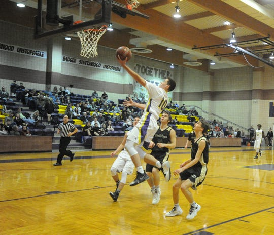 Merkel guard Dillon Davis lays it up on a fast break against Clyde