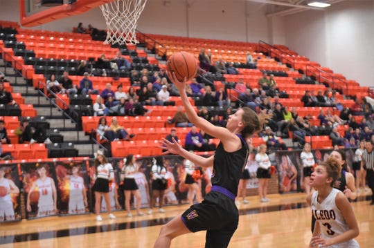 Wylie's Abbey Henson (10) makes a lay-up against Aledo in a District 4-5A game on Friday, Jan. 11, 2019. The Lady Bulldogs fell 59-56.