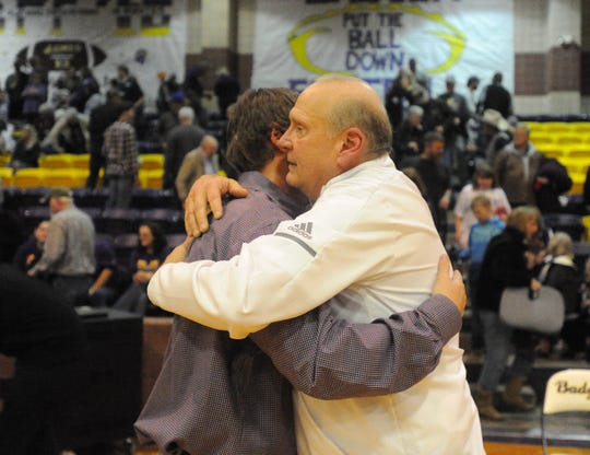 Clyde coach Marc Case, right, hugs Merkel coach B.C. Lee following the Badgers' 42-33 win Friday, Jan. 11, 2019. Lee played under Case at Cooper during the 2002-03 season.
