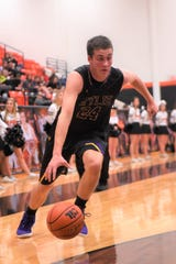 Wylie's Duncan Bacon (24) drives to the baseline against Aledo in a road District 4-5A contest on Friday, Jan. 11, 2019. The Bulldogs lost 62-60 in double-overtime.