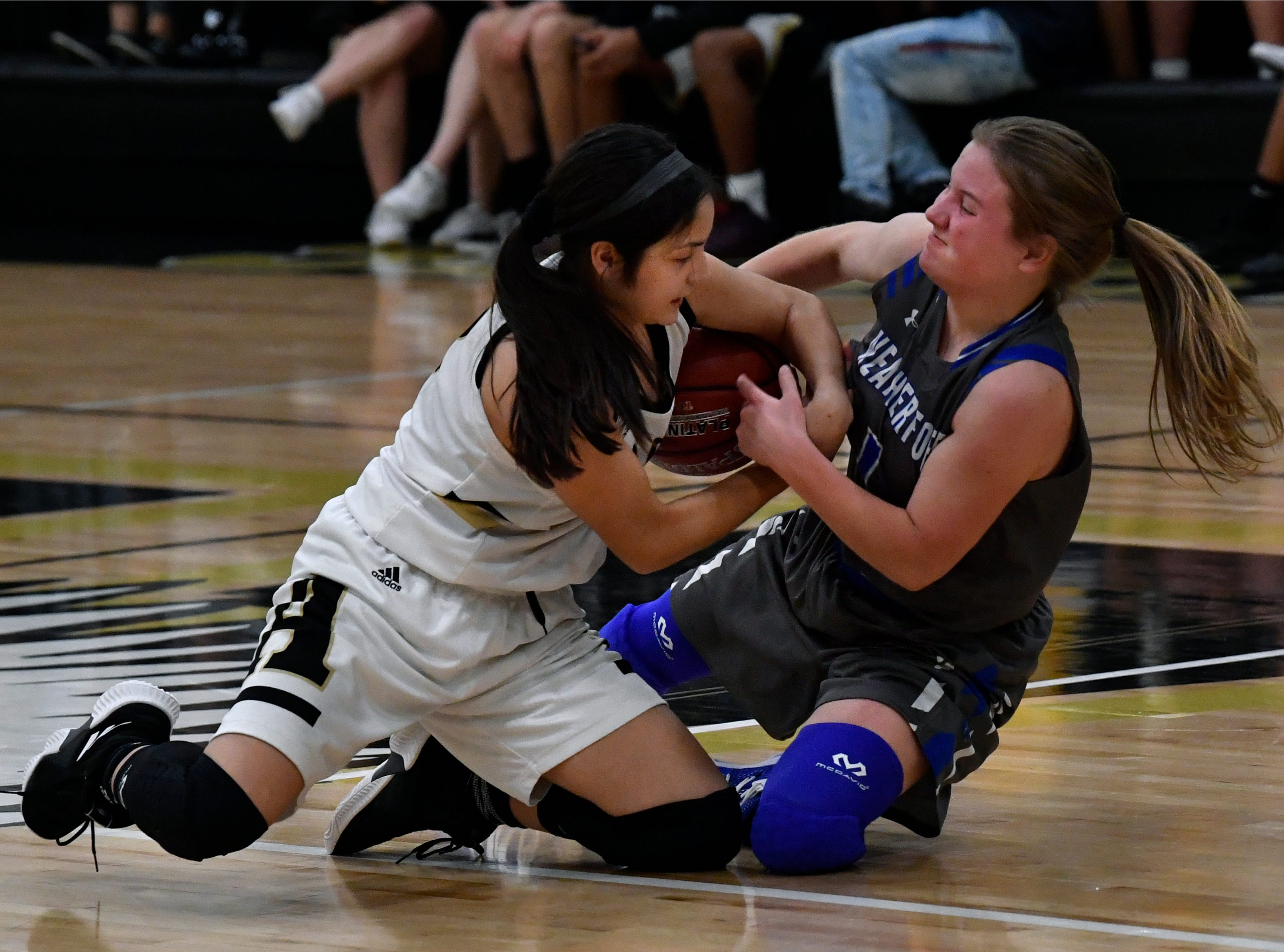 The Lady Eagles' Leila Musquiz pulls the ball from Weatherford's Emma Clark during Friday's basketball game at Abilene High Jan. 11, 2019. Final score was 51-38, Abilene.