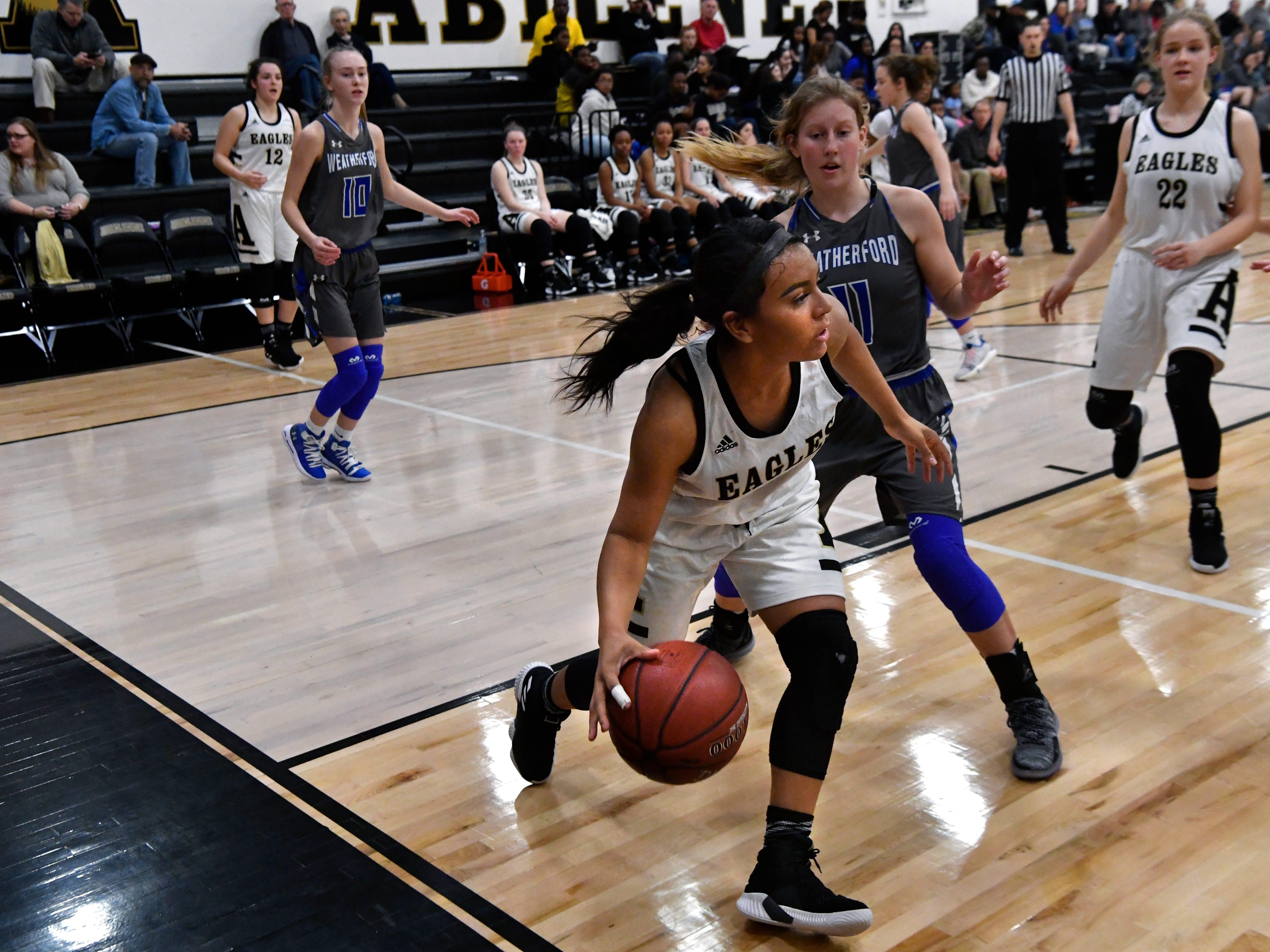 Alyssa Washington plays under the basket during Friday's game against Weatherford Jan. 11, 2019. Final score was 51-38, Abilene.