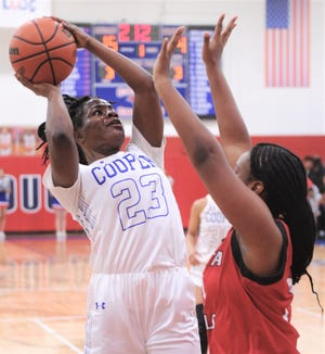 Cooper's Dazz Larkins (23) shoots over a Wichita Falls High defender. Cooper beat the Lady Coyotes 71-29 in the District 4-5A game Friday, Jan. 11, 2019, at Cougar Gym.