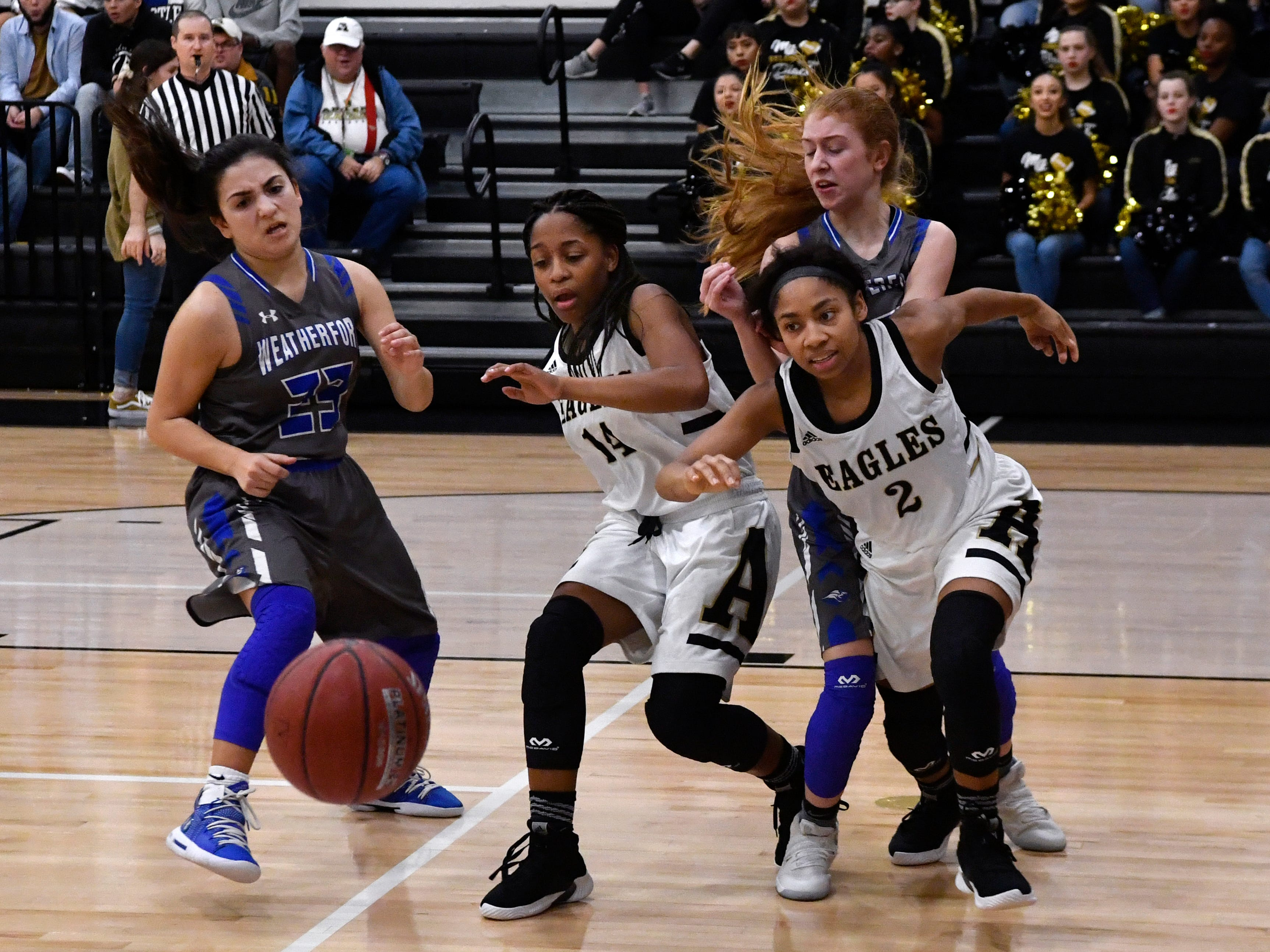 Lady Eagles Brooklin Ellis (right) and Tavia Wilson chase the ball during Friday's game against Weatherford Jan.11, 2019. Final score was 51-38, Abilene.