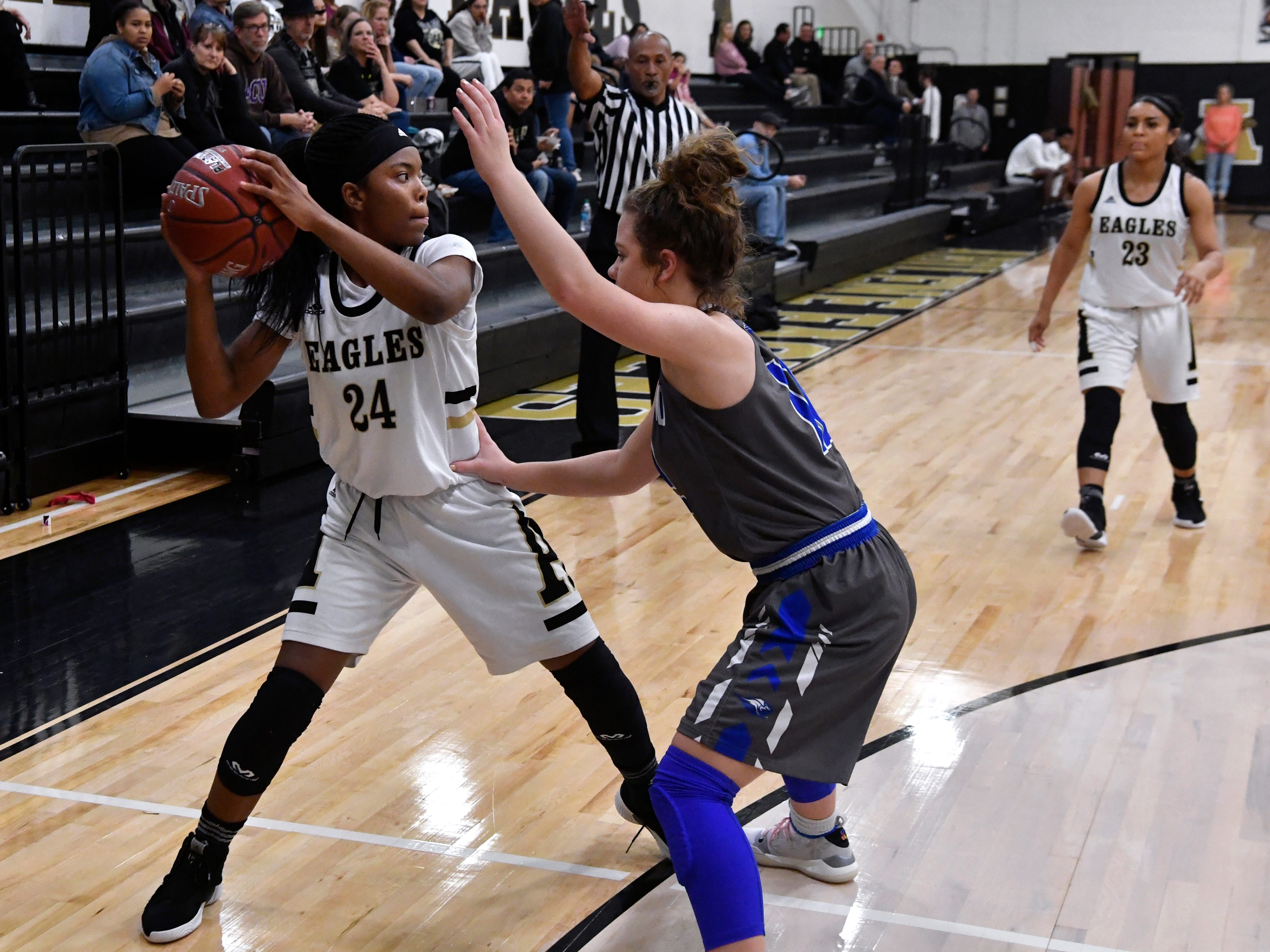 Lady Eagles' Trakenya Roberson is guarded by Weatherford's Hannah Kness during Friday's game at Abilene High Jan. 11, 2019. Final score was 51-38, Abilene.