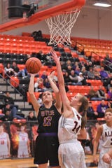Wylie's Karis Christian (12) puts up a shot against Aledo in a District 4-5A game on Friday, Jan. 11, 2019. The Lady Bulldogs fell 59-56.