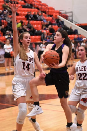 Wylie's Mary Lovelace (24) goes into the air for a shot against Aledo in a District 4-5A game on Friday, Jan. 11, 2019. The Lady Bulldogs fell 59-56.
