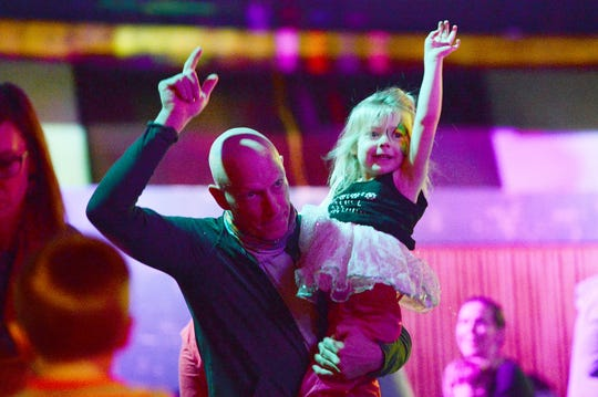 Tony Spainhour holds his daughter, Nosara, 4, as they dance during Kid Hop Hooray! A Wintertime indoor dance party at the Orange Peel on Jan. 12, 2019. The family-friendly event gave children a chance to get out their energy without worrying about with cold with a live DJ, face painting, ice cream from The Hop and snacks for sale.