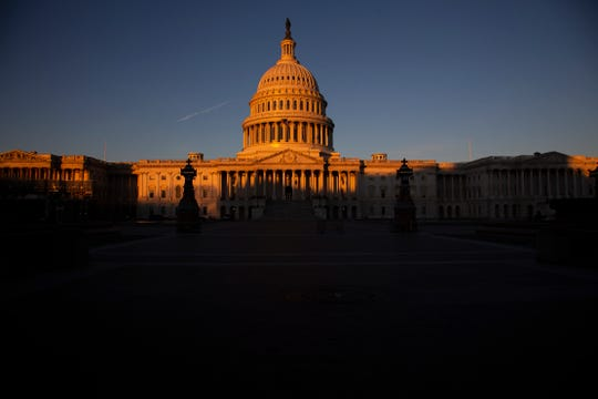 The Capitol is seen at dawn on the 21st day of a partial government shutdown as an impasse continues between President Donald Trump and Democrats on funding his promised wall on the U.S.-Mexico border, in Washington, Friday, Jan. 11, 2019. A new era of divided government began this year with the 116th Congress as the Democrats took control of the House, with Republicans still holding the majority in the Senate. (AP Photo/J. Scott Applewhite)